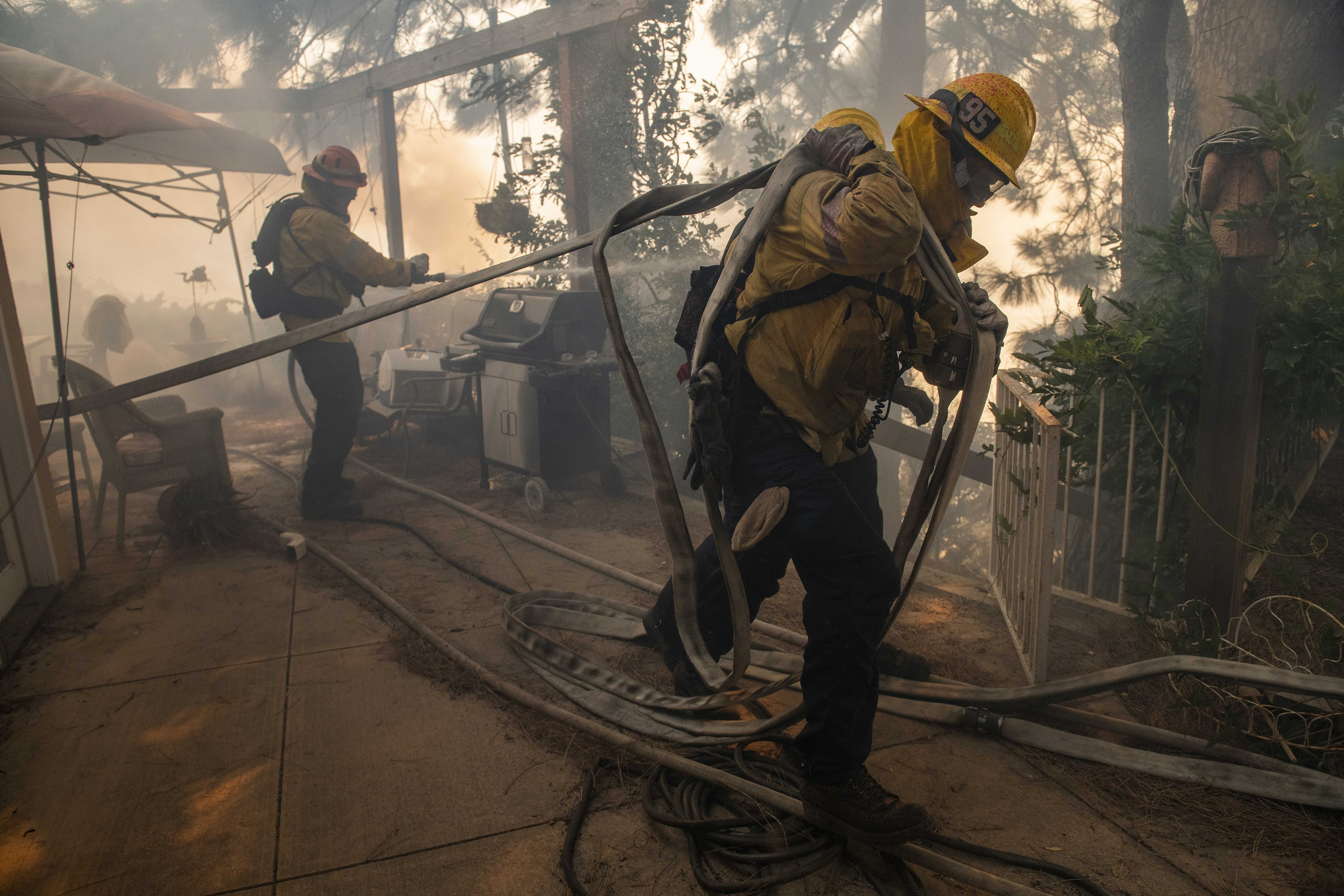 AP PHOTOS: Wildfires batter northern, southern California