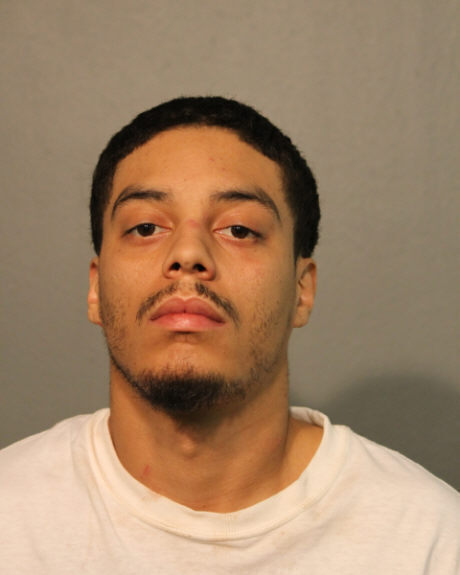Parents charged after Chicago boy shot in struggle over gun