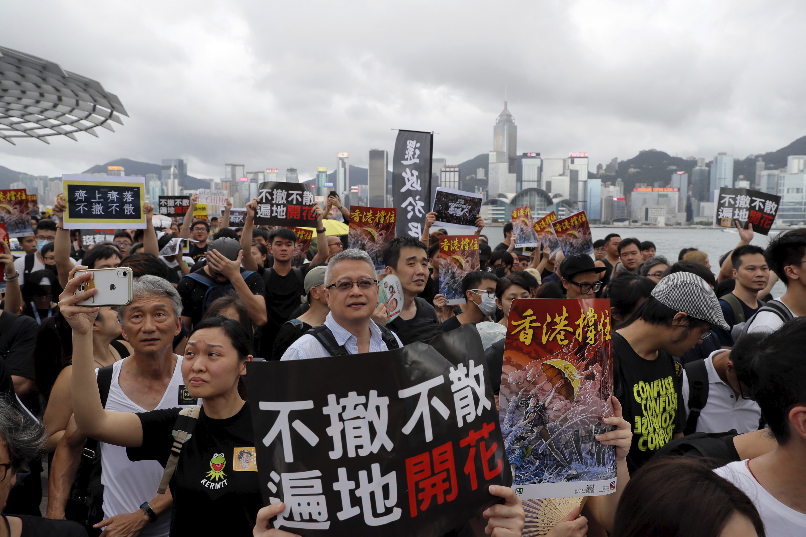 Tens of thousands in Hong Kong take message to mainlanders