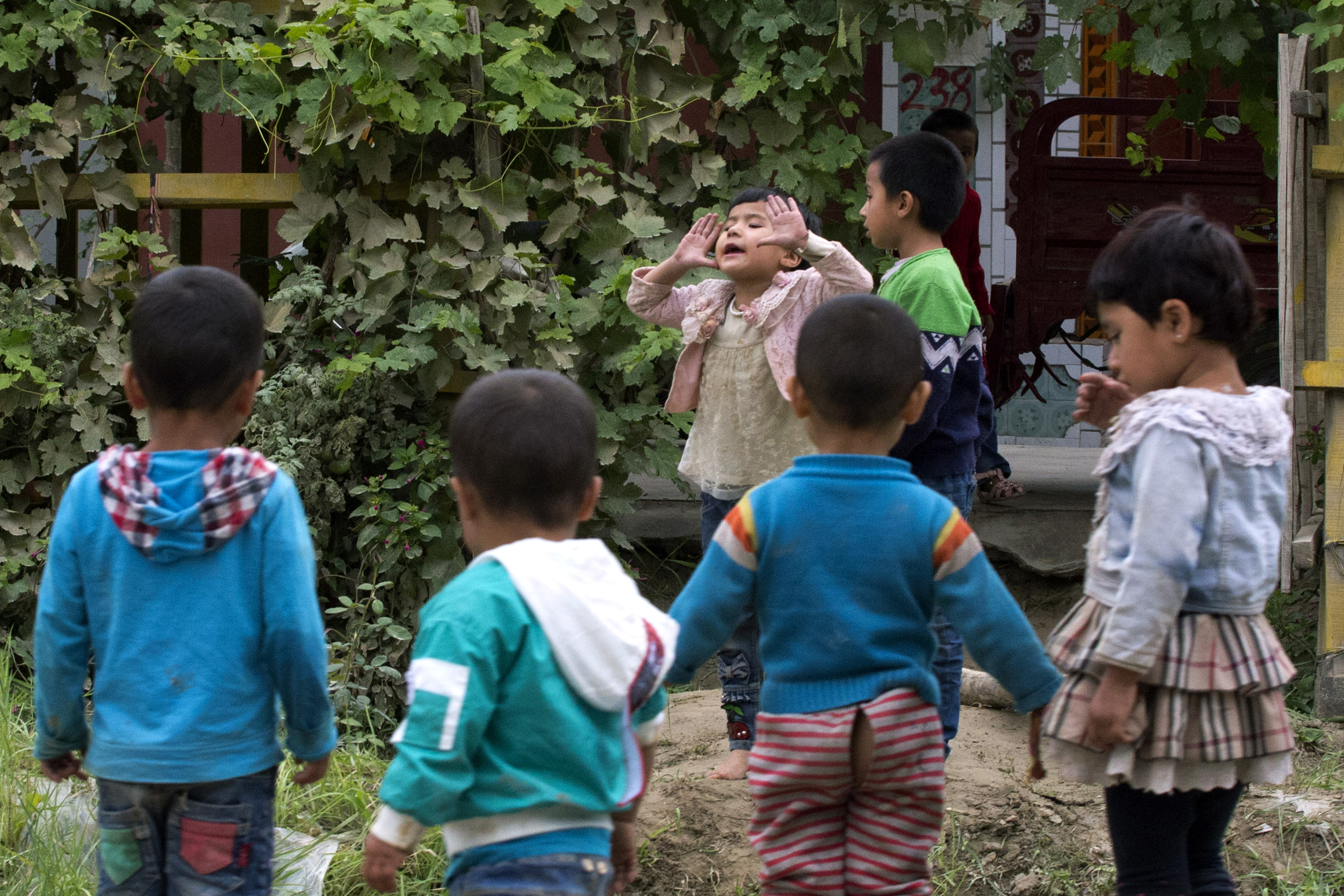 China cuts Uighur births with IUDs, abortion, sterilization