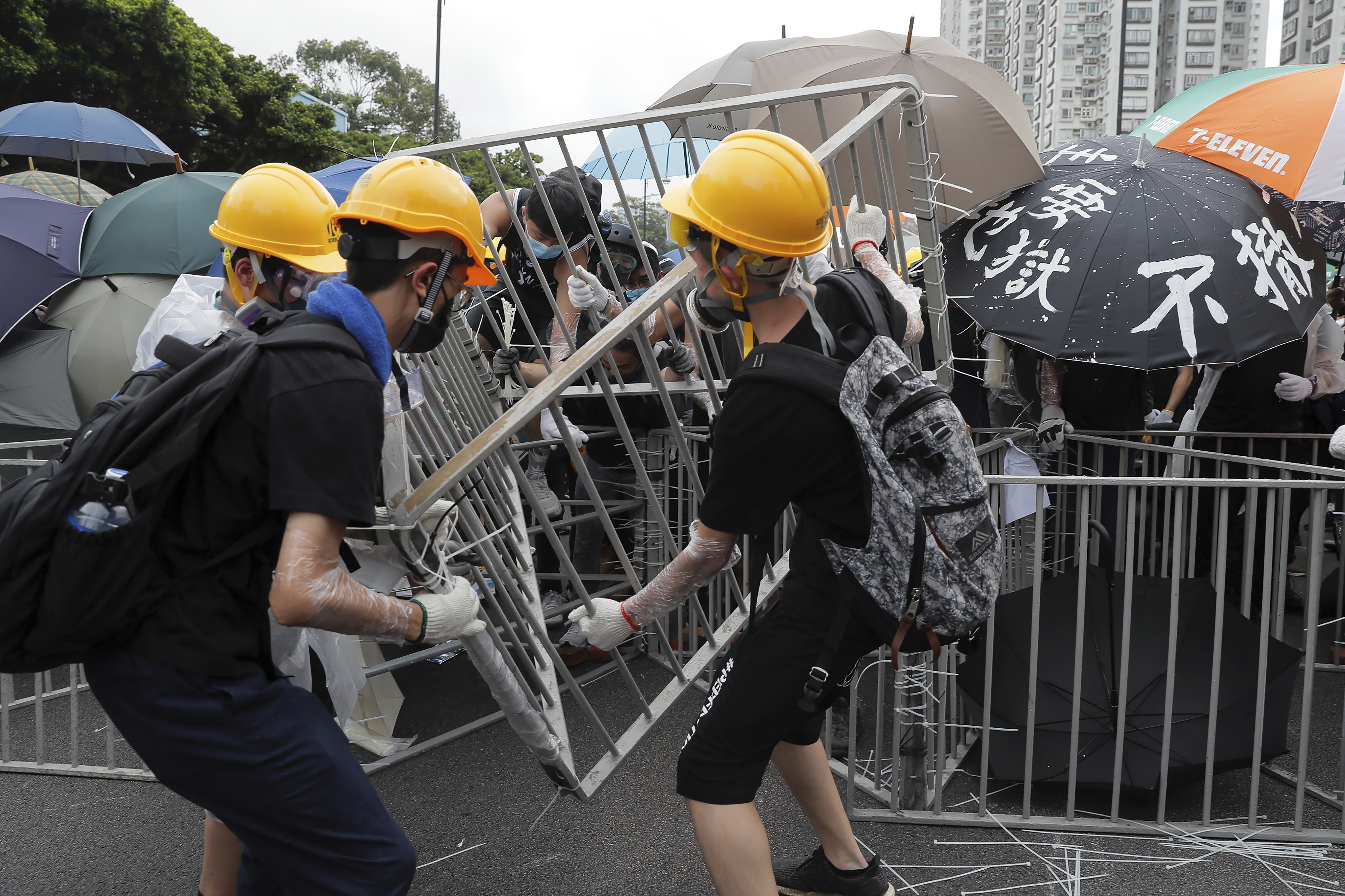 The Latest: Hong Kong police fight with protesters