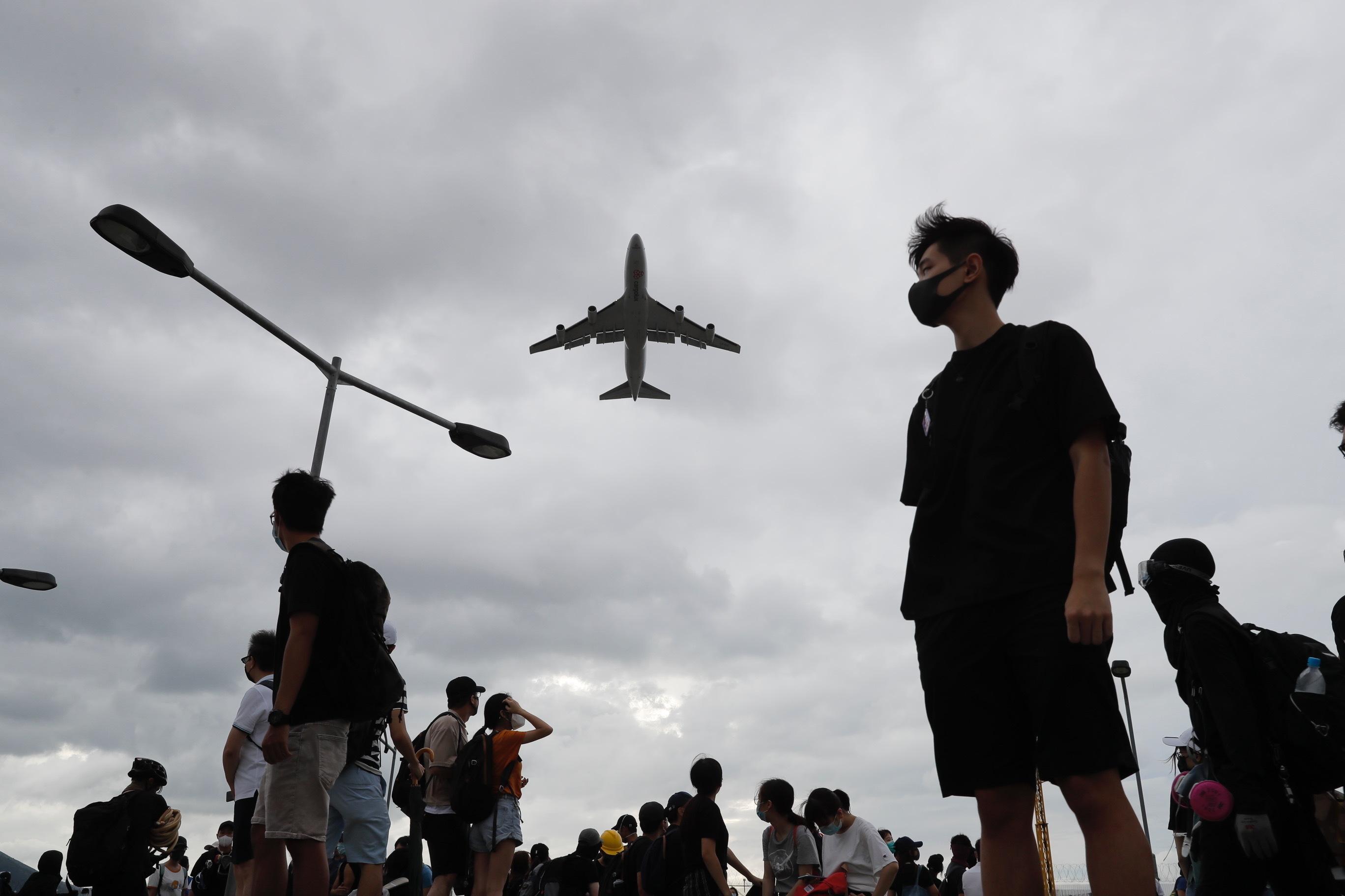 Protesters block roads near Hong Kong airport