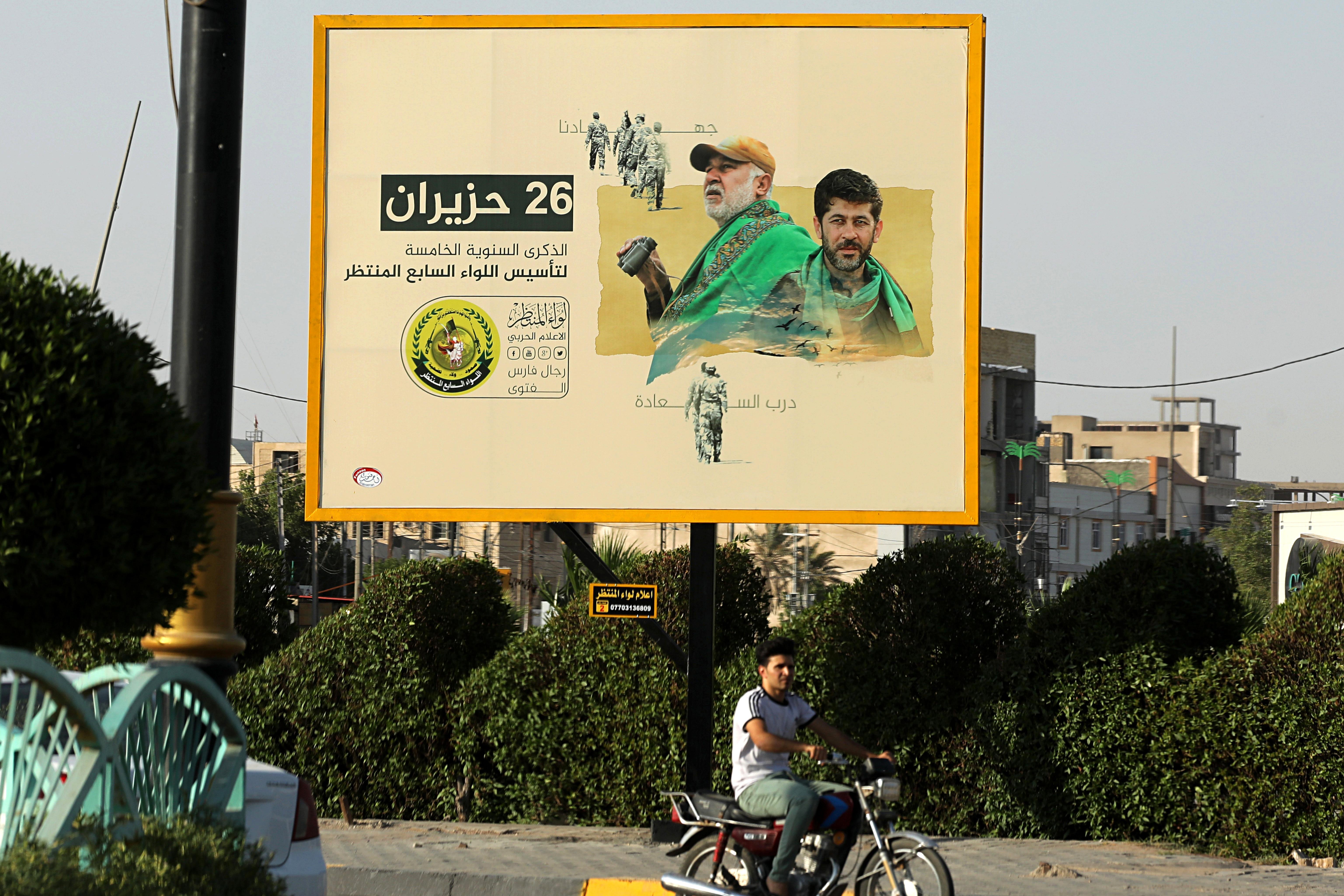 The Latest: Iran-backed militia criticizes Iraq PMs order