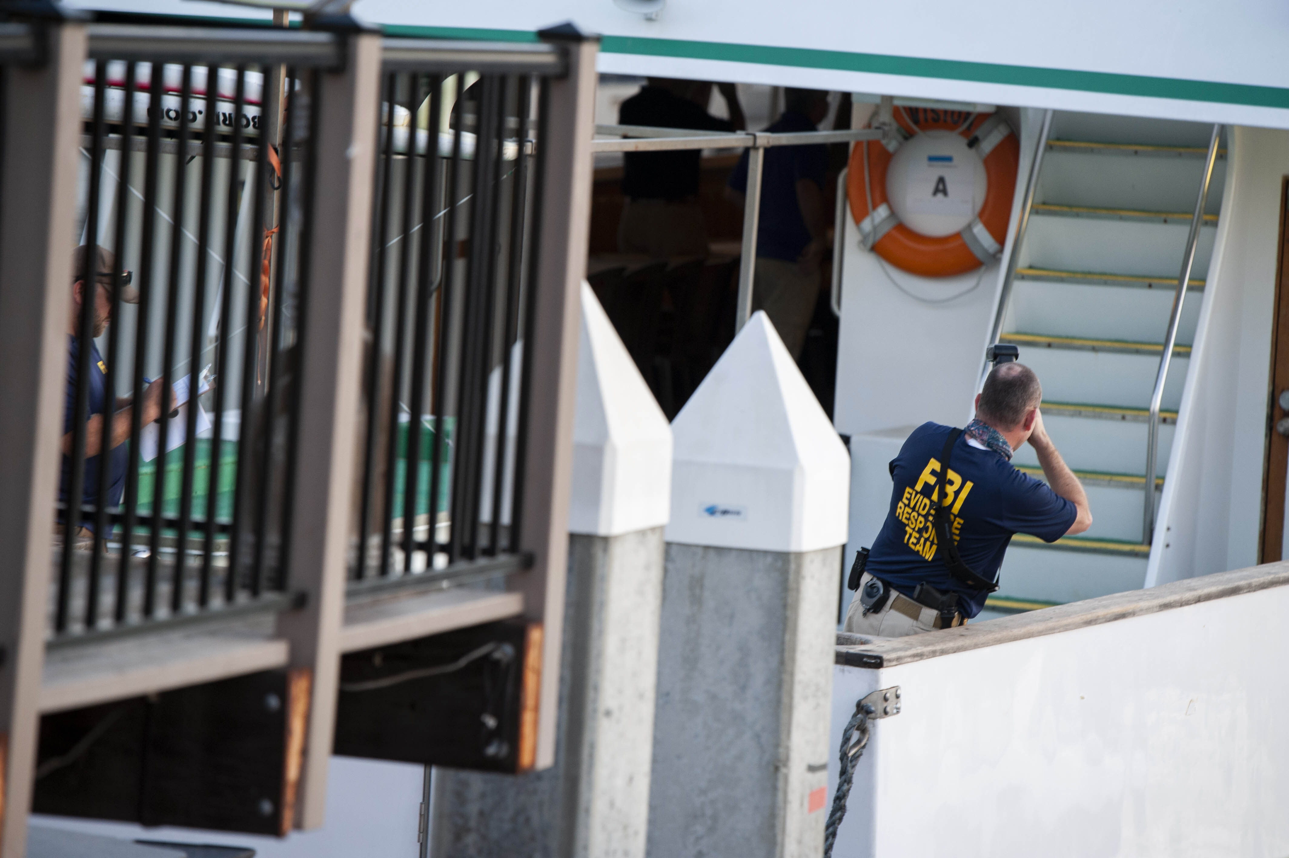 The Latest: Dive boat owner says crew tried to reach victims