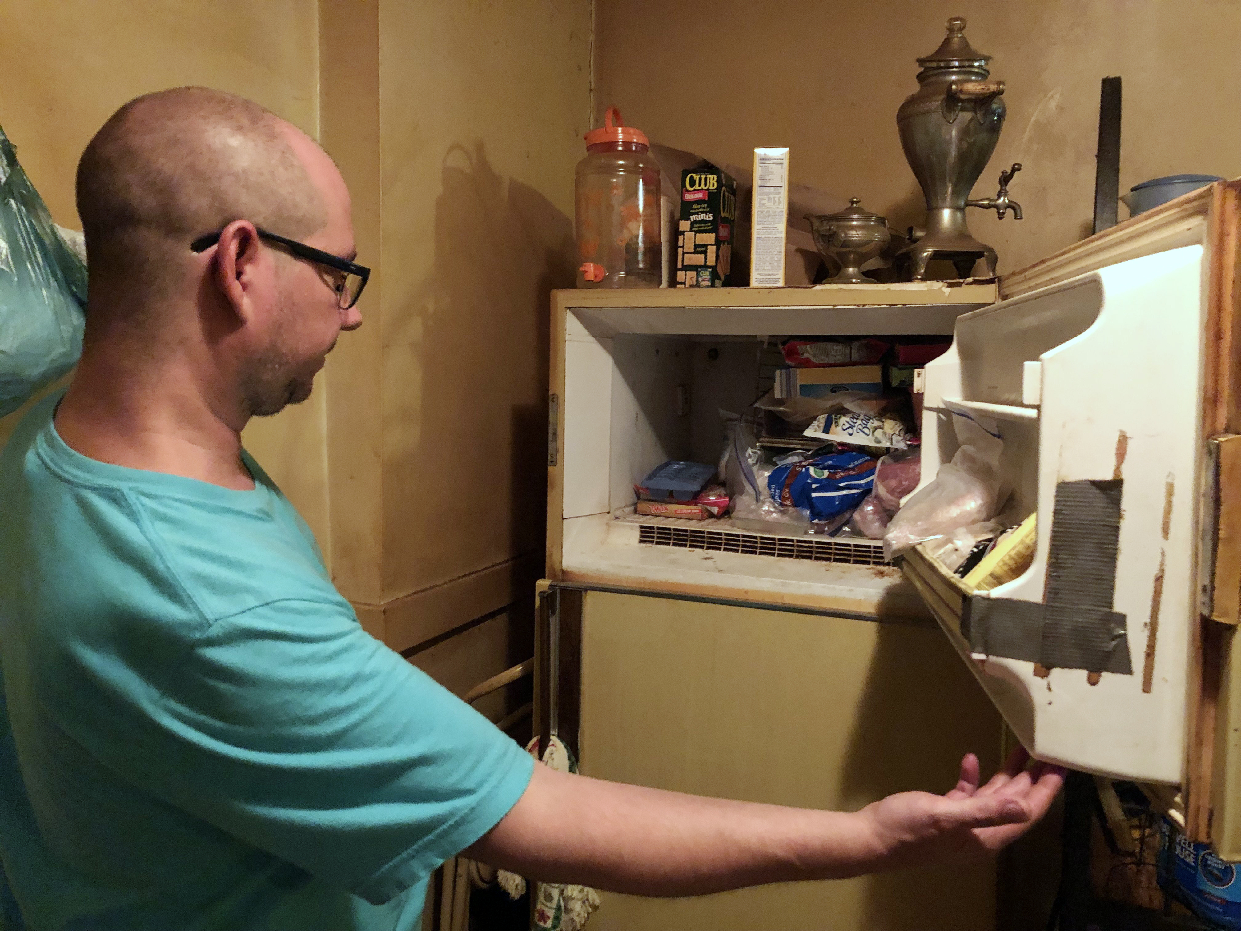 Police investigate after man says he found baby in freezer