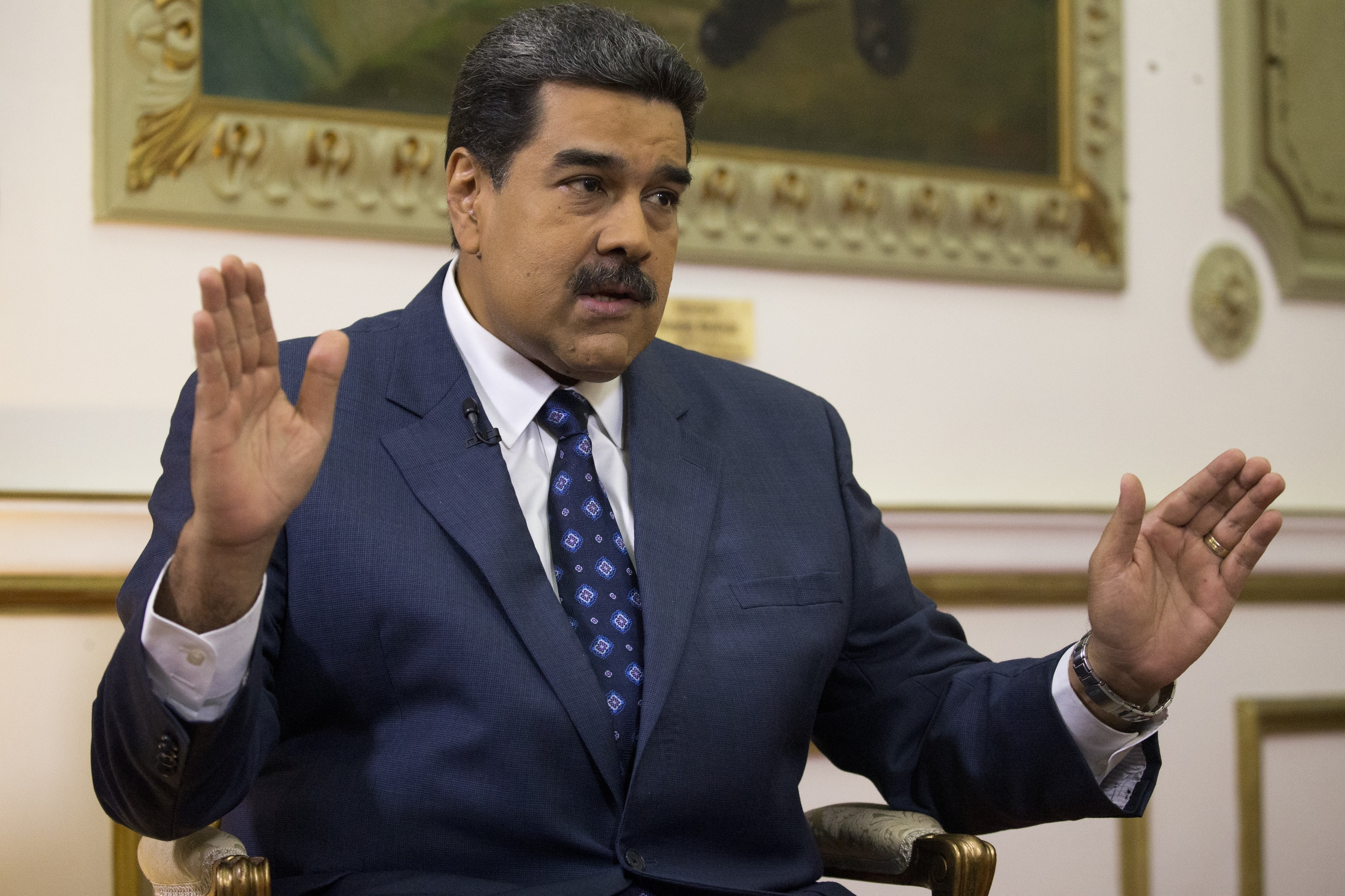 Maduro rejects talks with opposition over envoys remarks