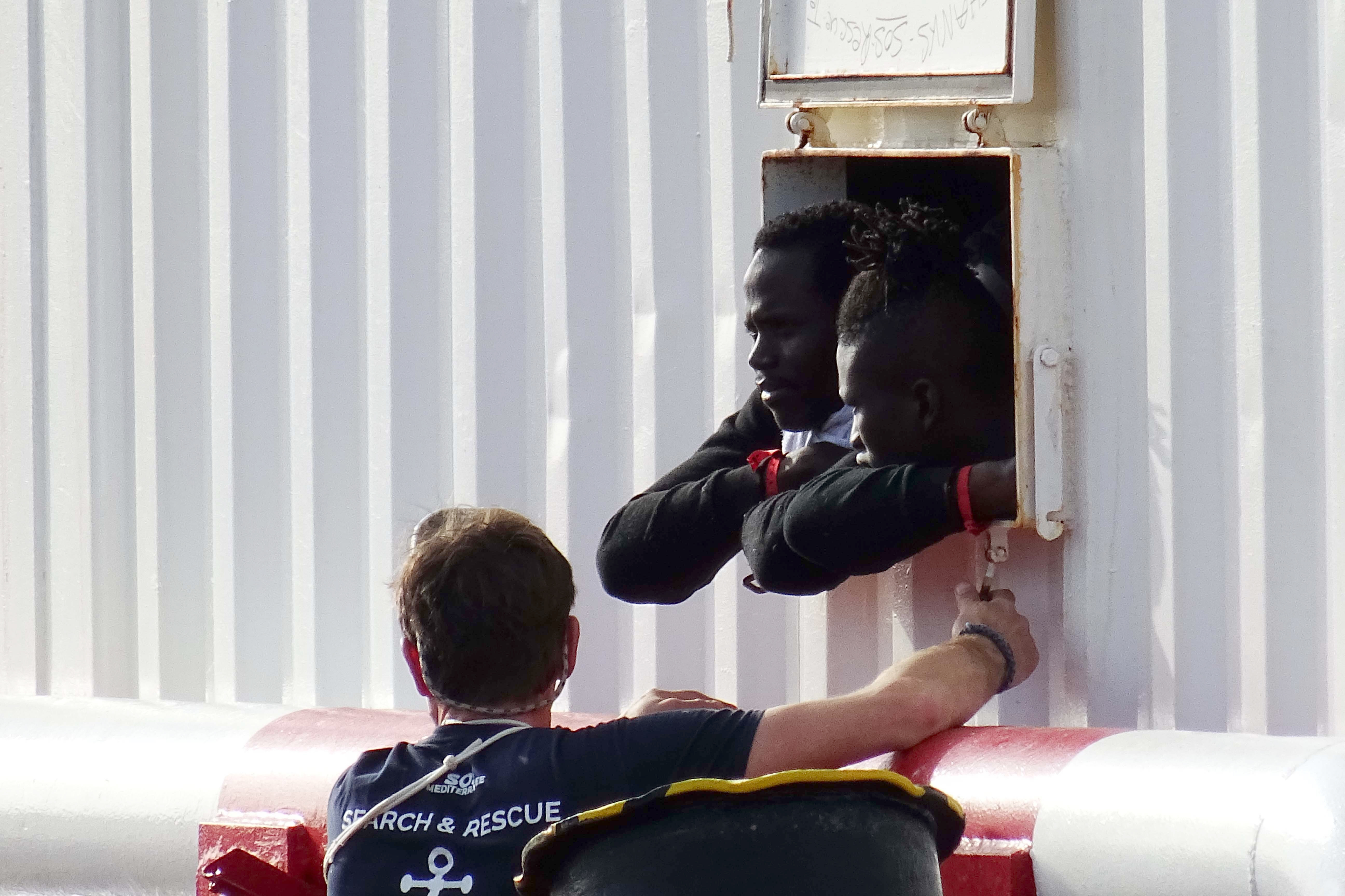 Aid ship with 403 migrants rescued off Libya docks in Italy