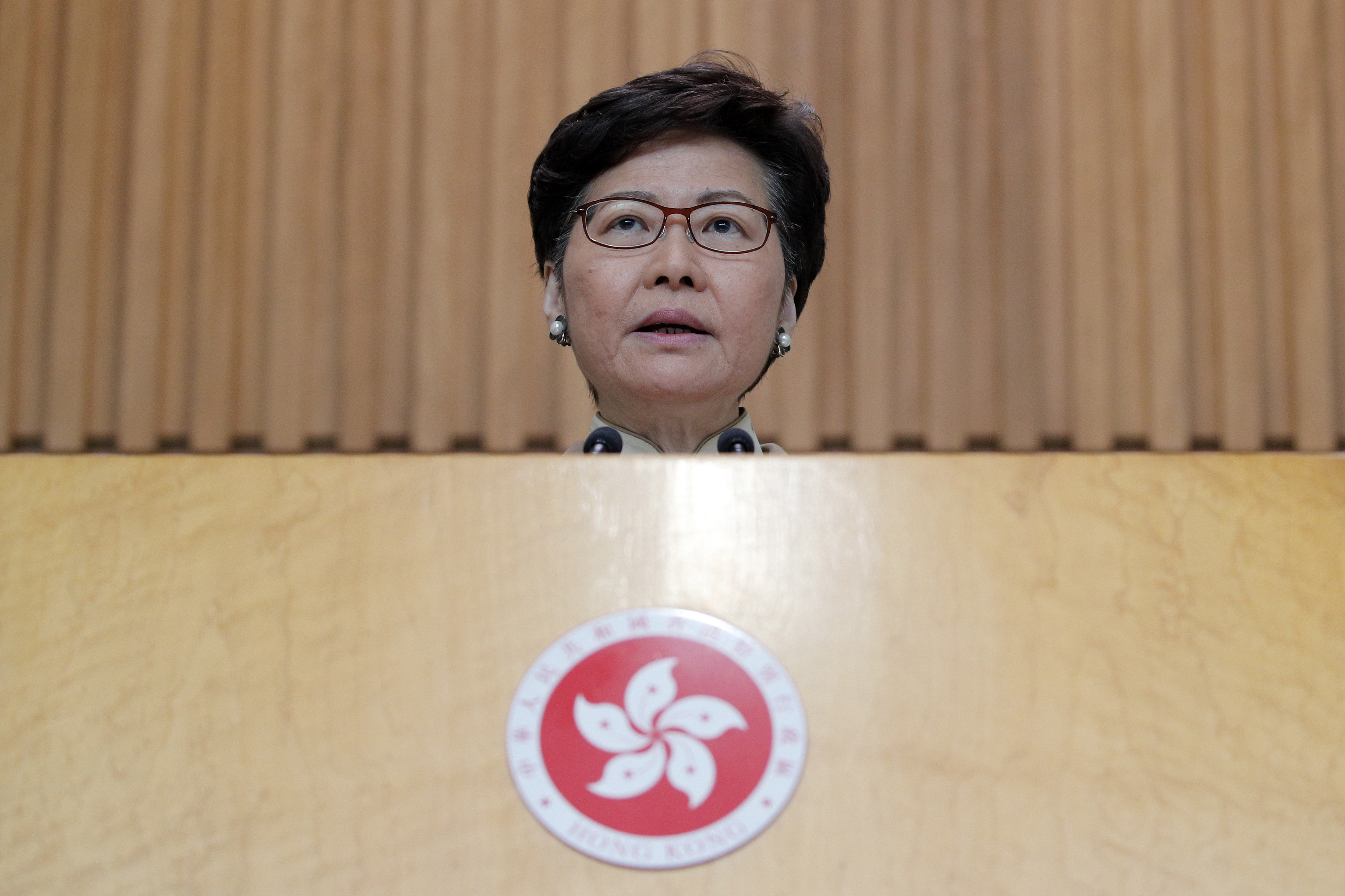 Hong Kong leader says new year will be a challenging one