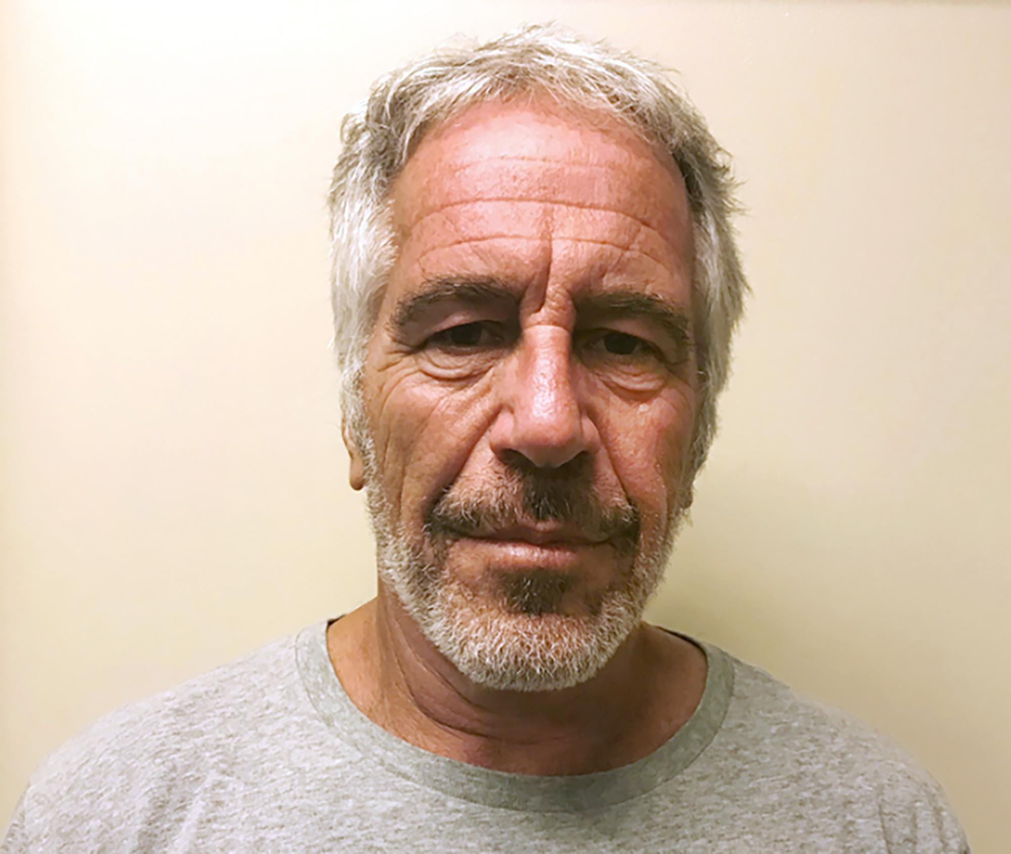 The Latest: Epstein accuser sues his estate, ex-girlfriend
