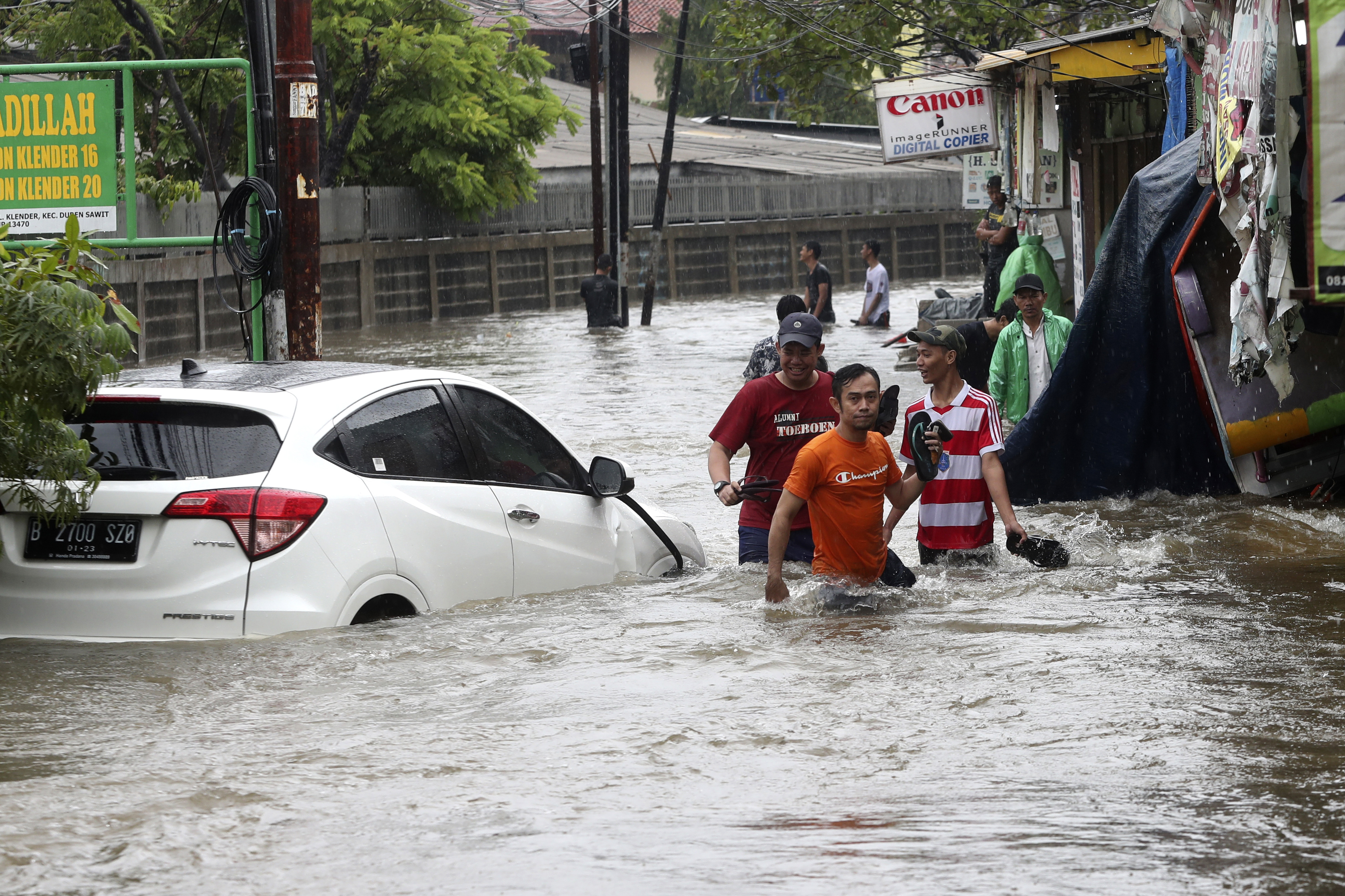 16 dead, thousands caught in flooding in Indonesias capital