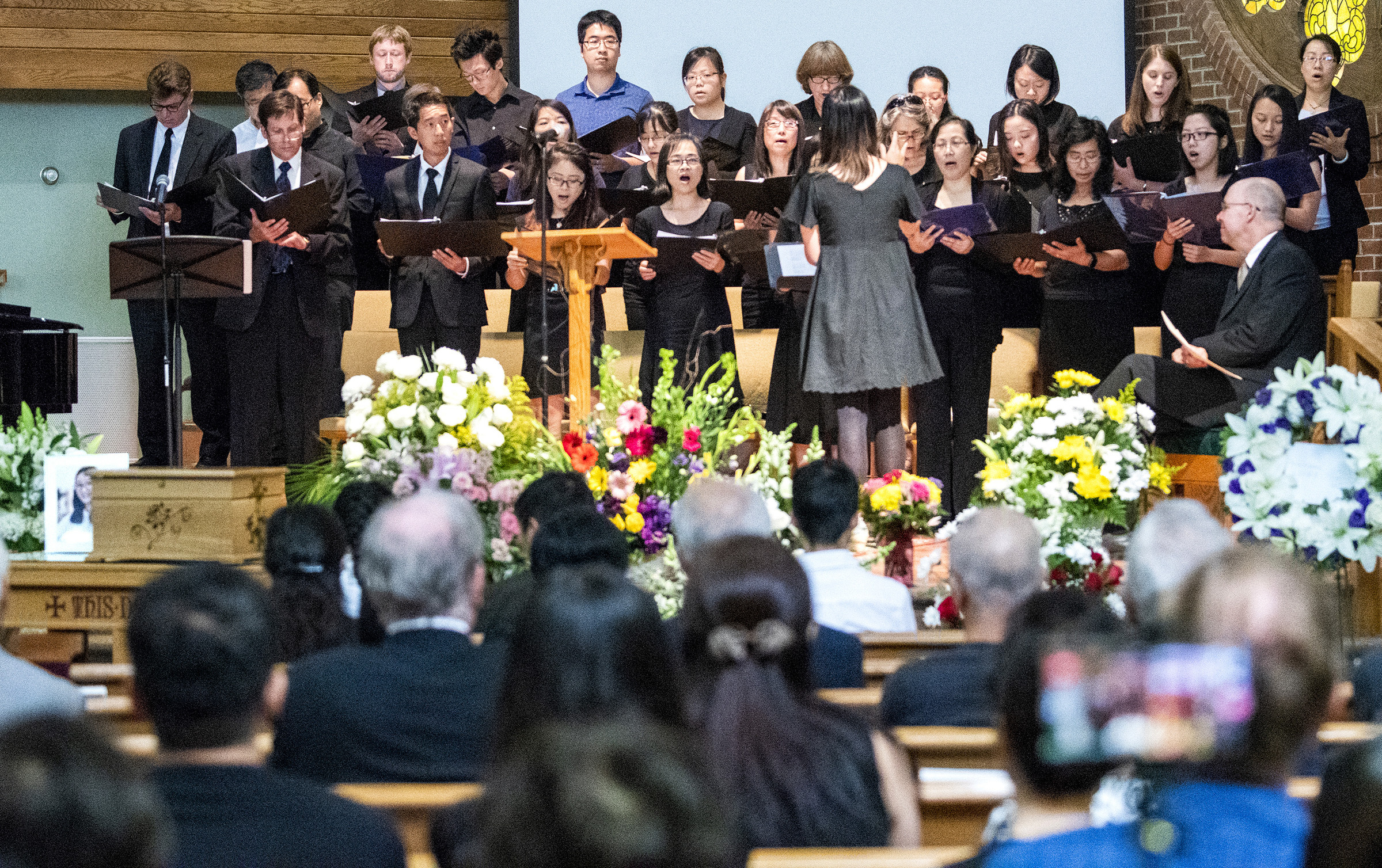 Family of slain Chinese scholar holds memorial