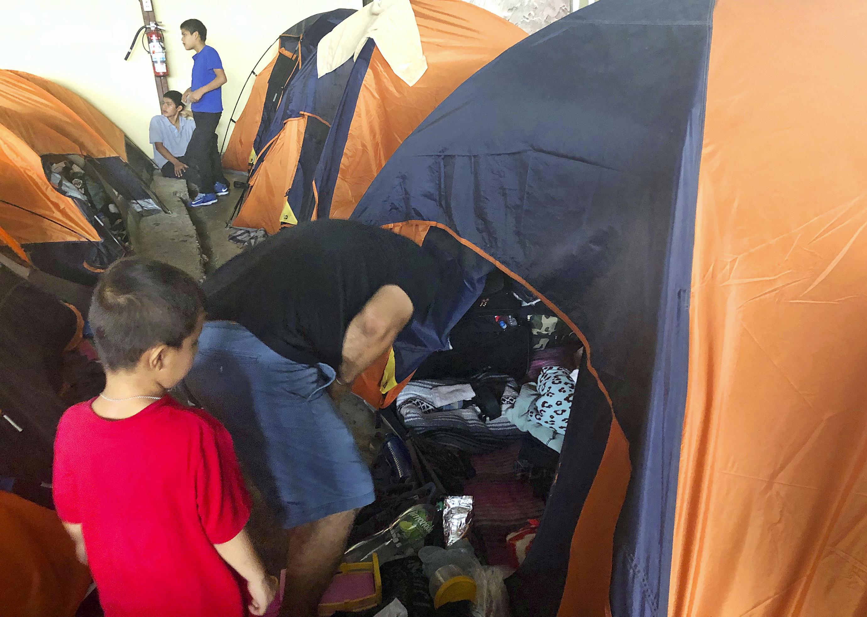 Groups: Migrants told to wait in Mexico faced bait, switch