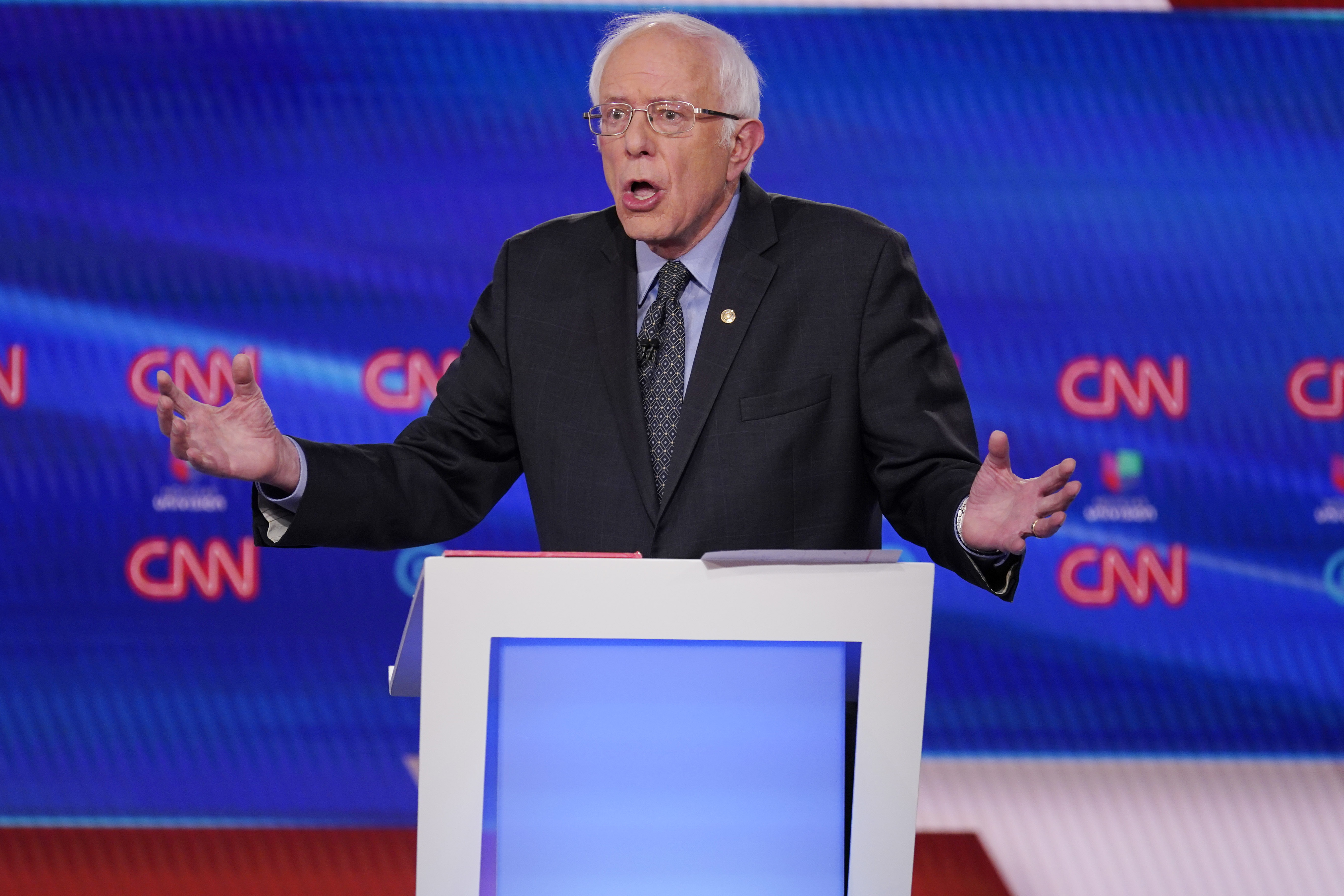 The Latest: Sanders, Biden debate Social Security backing