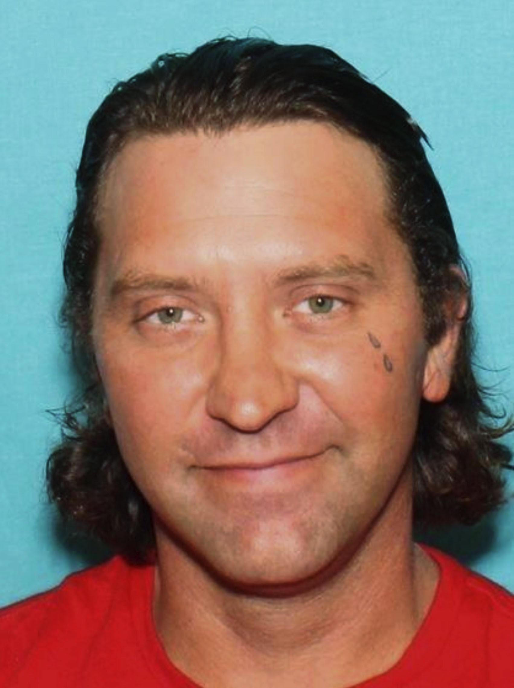The Latest: Neighbor says gunman was violent, aggressive