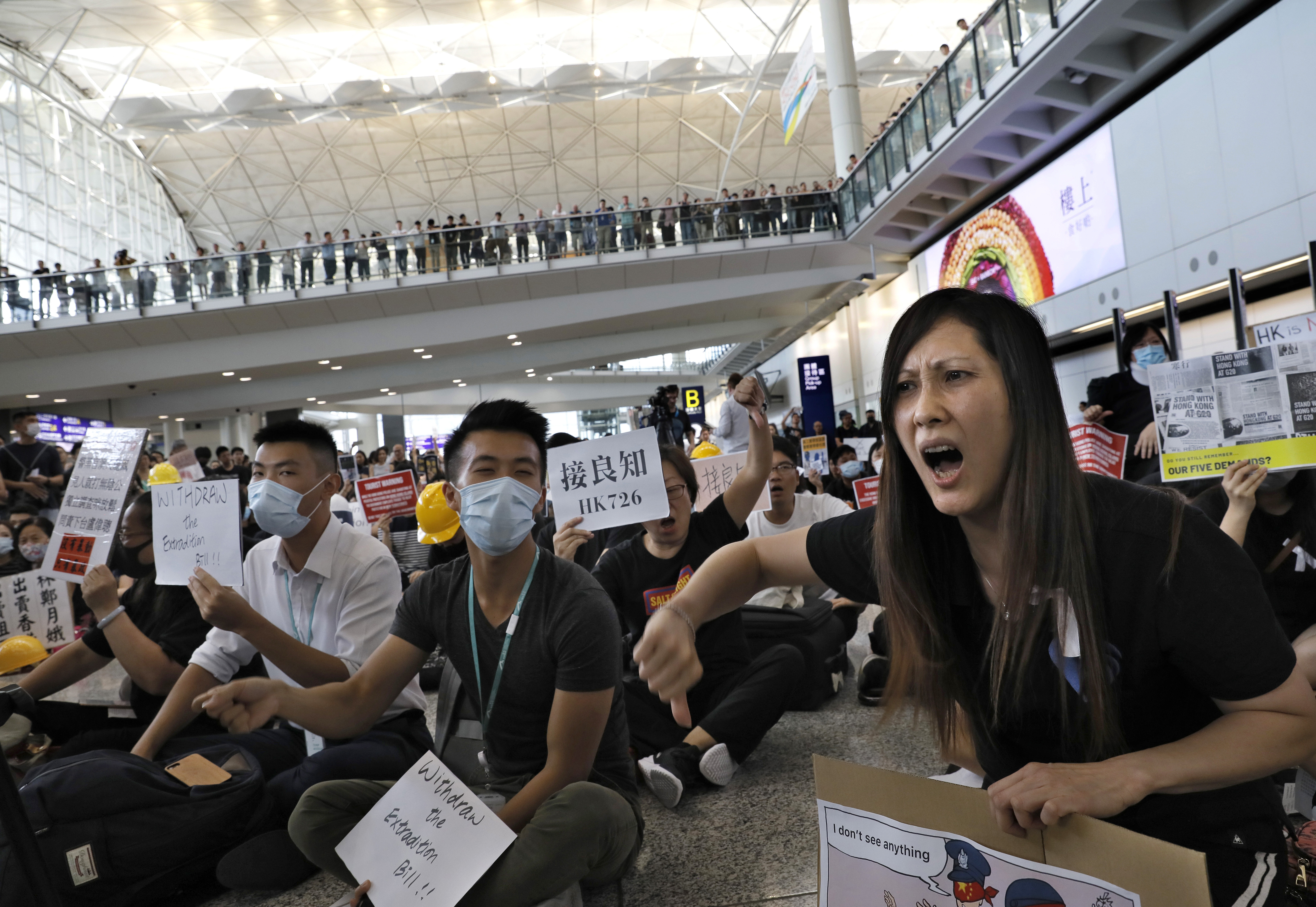 Hong Kong protesters take their cause to airport arrivals