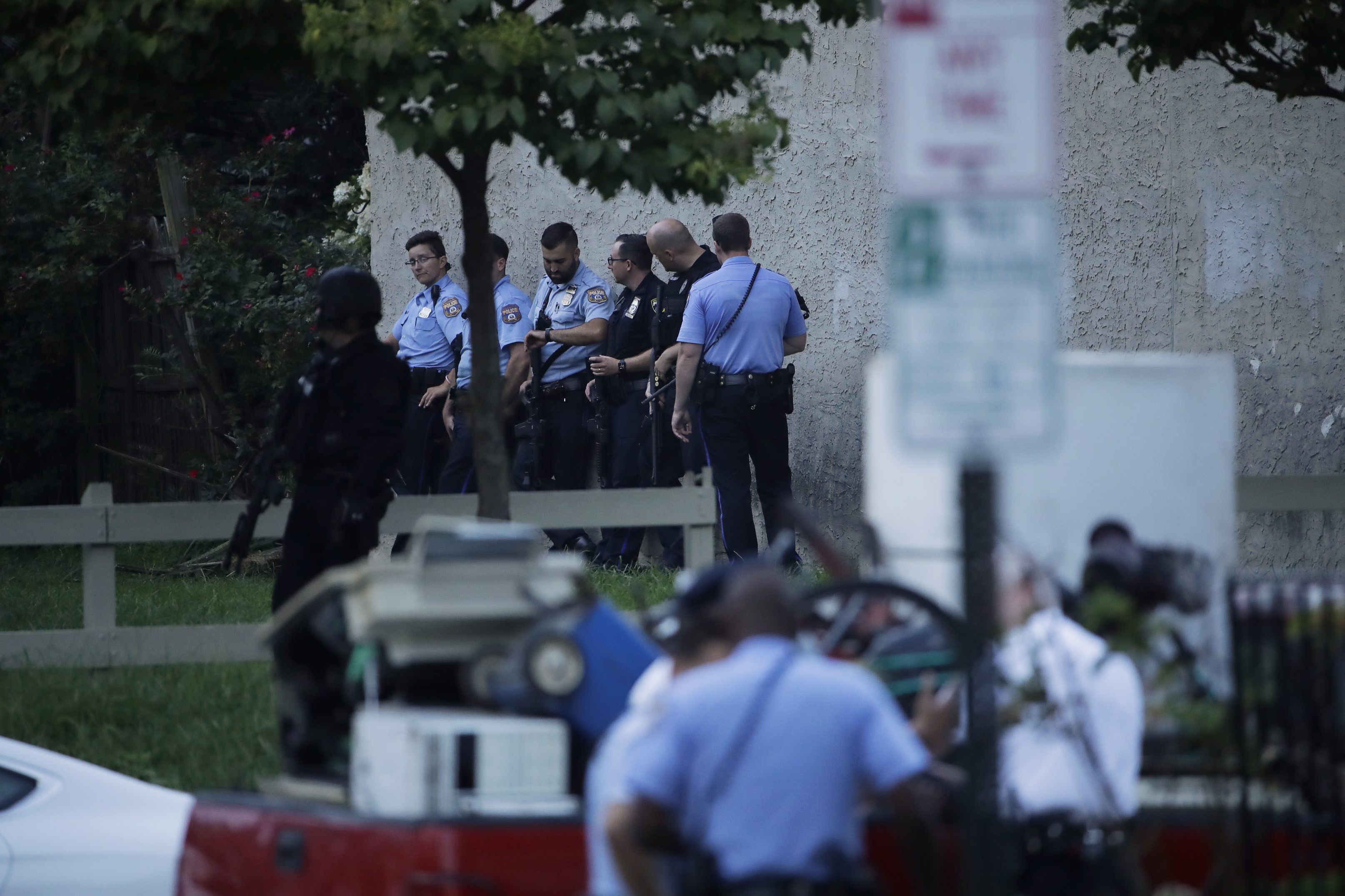 Gunman wounds at least 6 Philadelphia police; 2 others freed