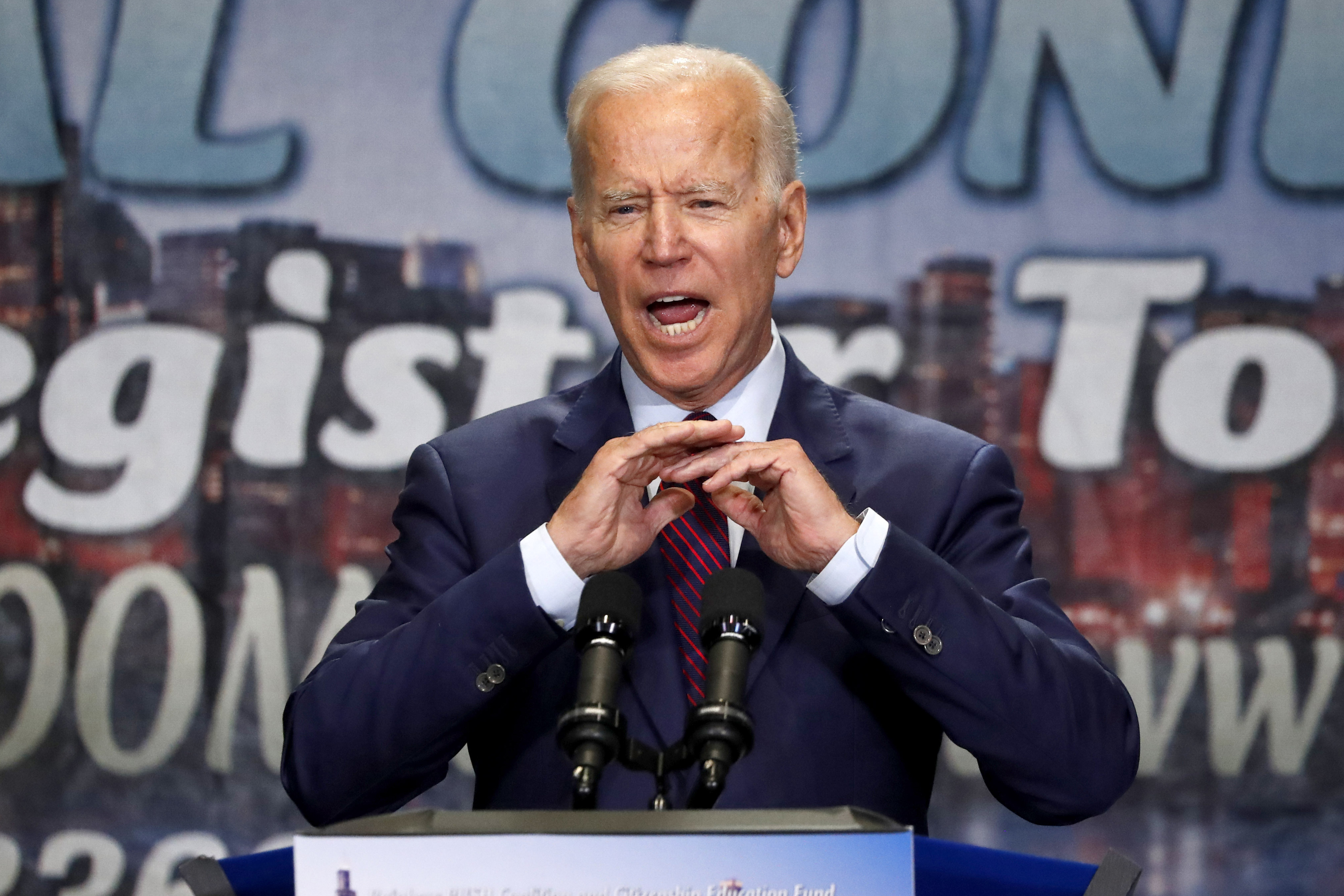 Biden defends past civil rights record after Harris attack