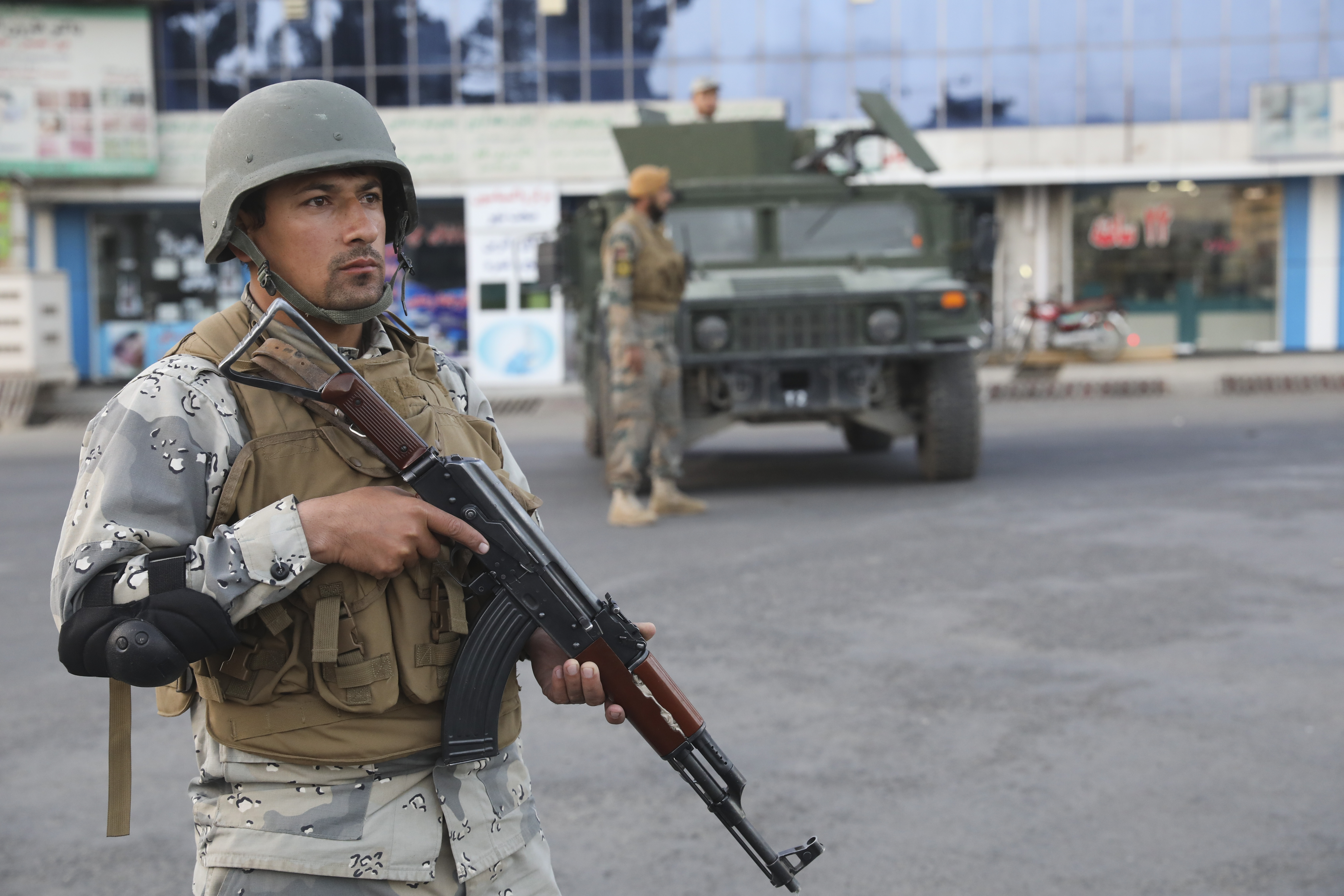 The Latest: Afghan polls close amid complaints, violence