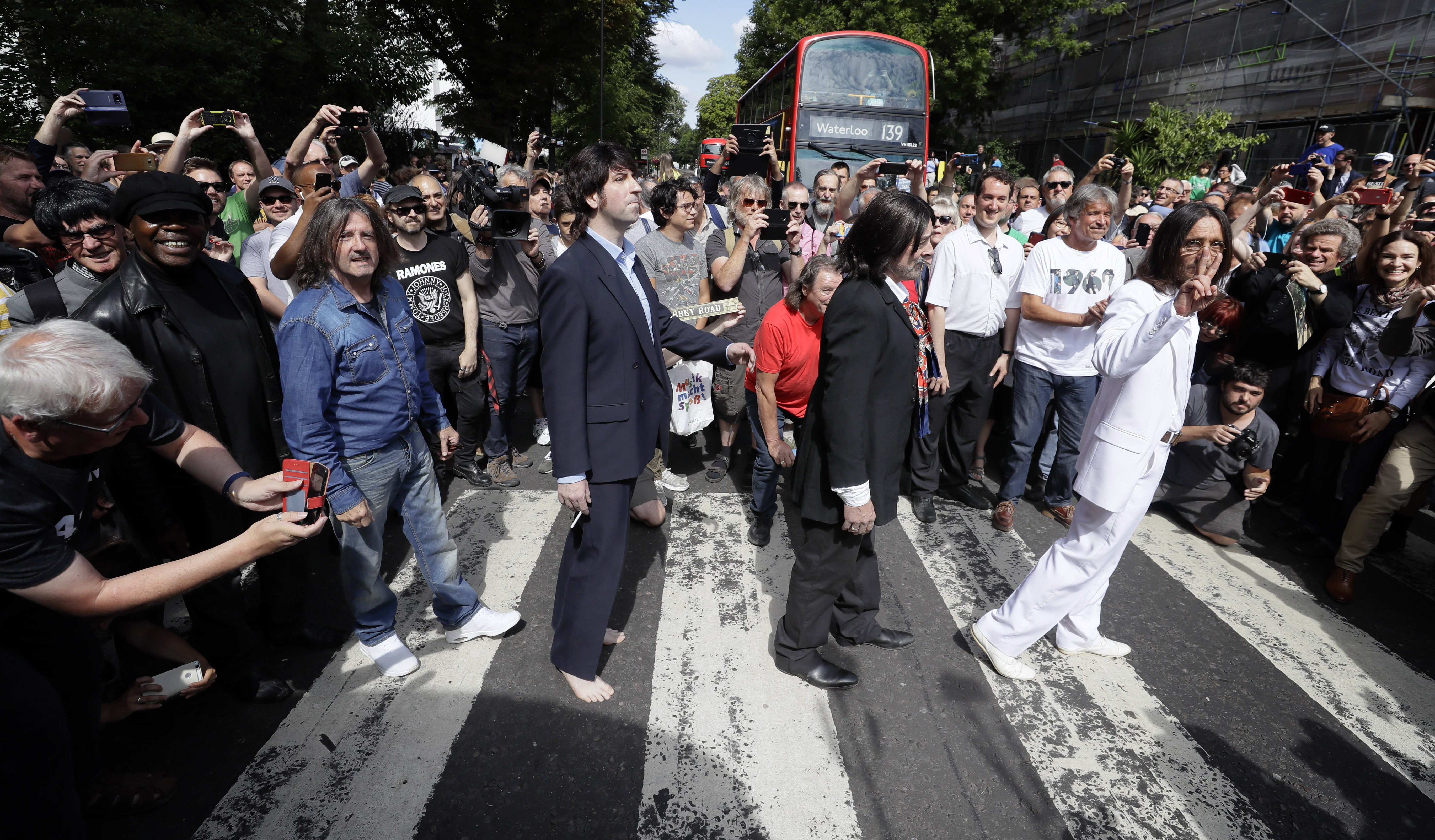 Fans recreate Beatles Abbey Road cover shot 50 years on