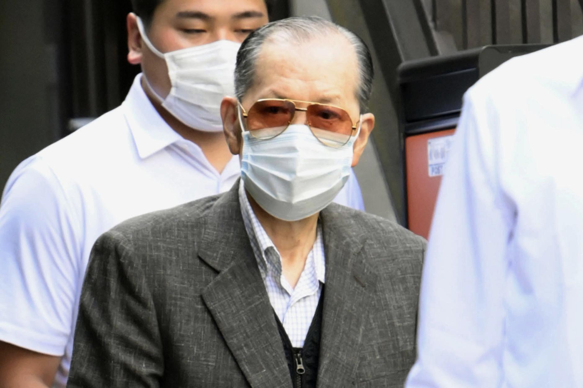 Japan police arrest fraud suspect linked to ex-PMs event