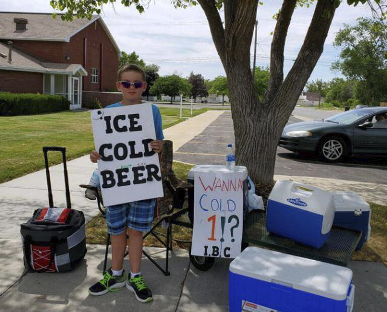 Utah boy advertises Ice Cold Beer at root beer stand