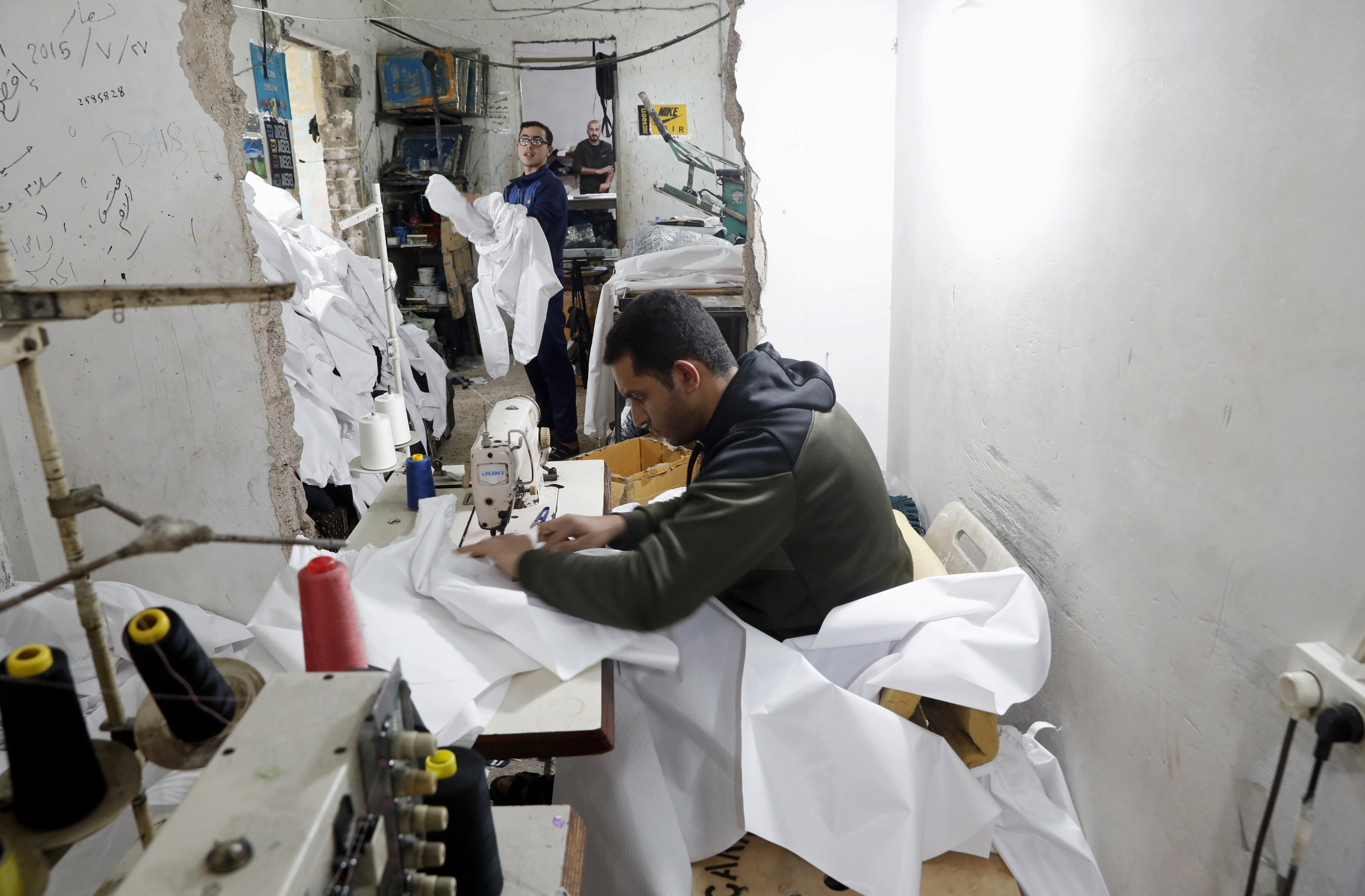 Gaza factories roar back to life to make protective wear