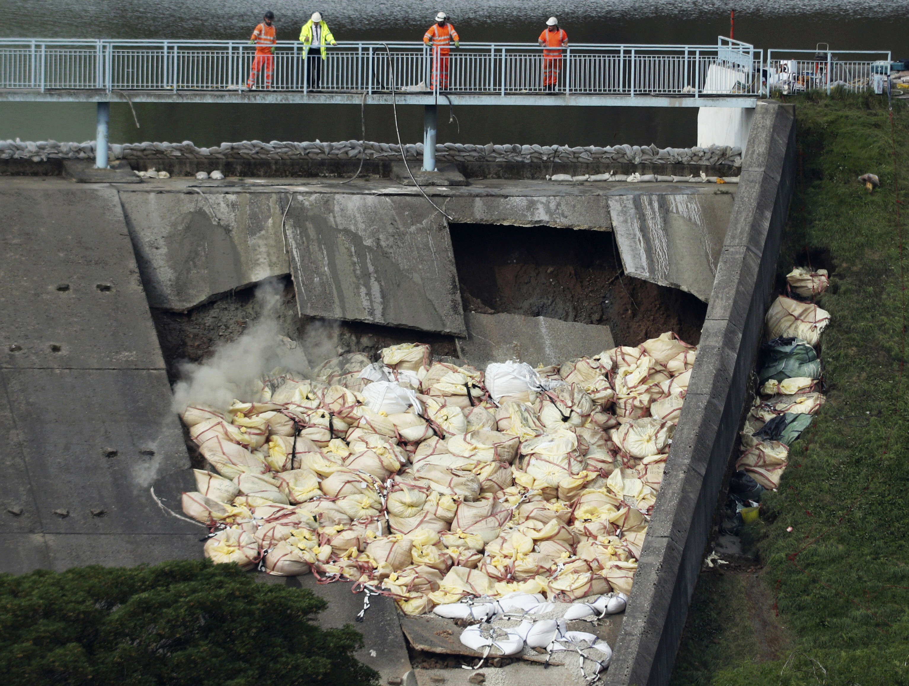 UK emergency workers race to cut water levels at damaged dam