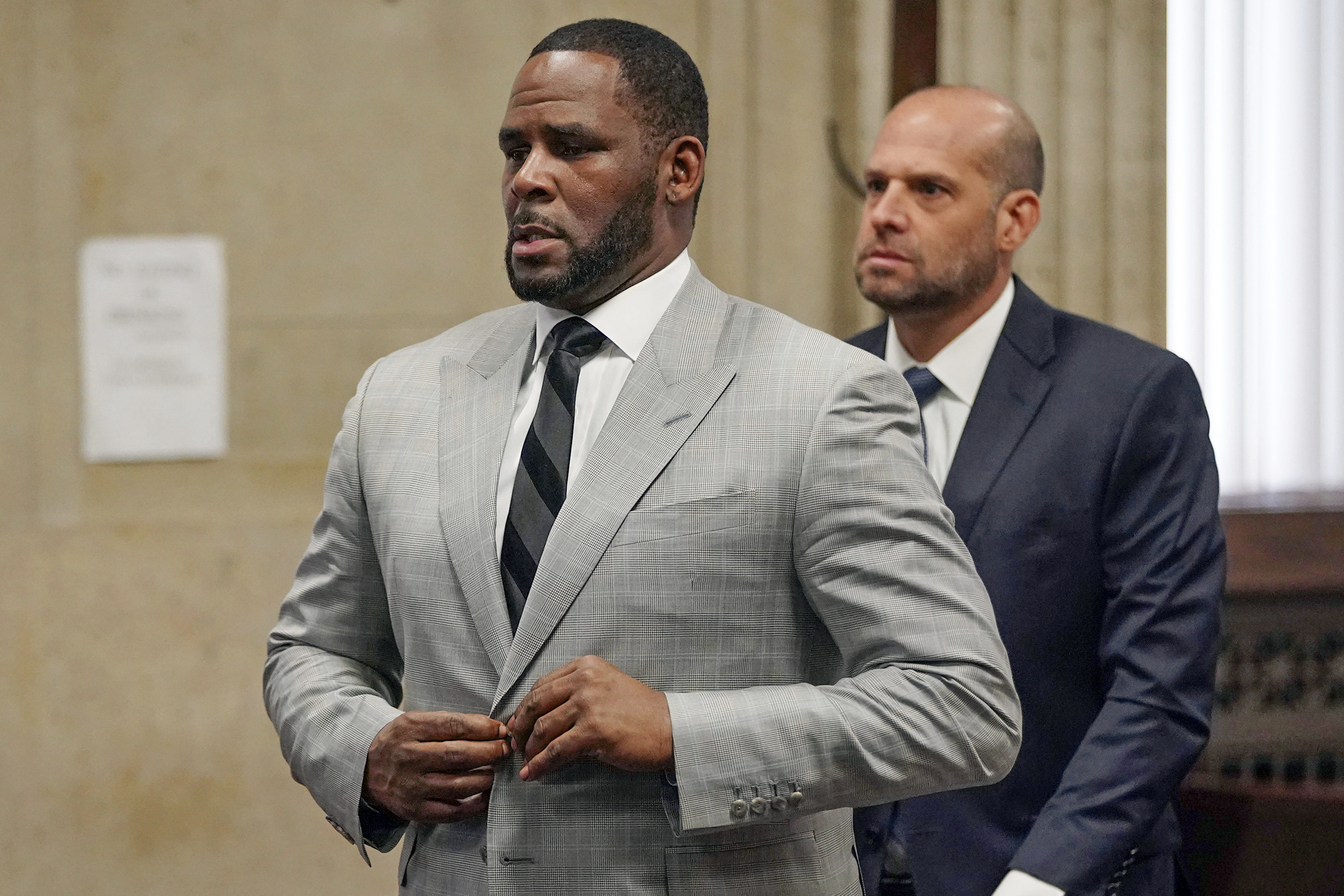 R. Kelly pleads not guilty; feds say new charges planned