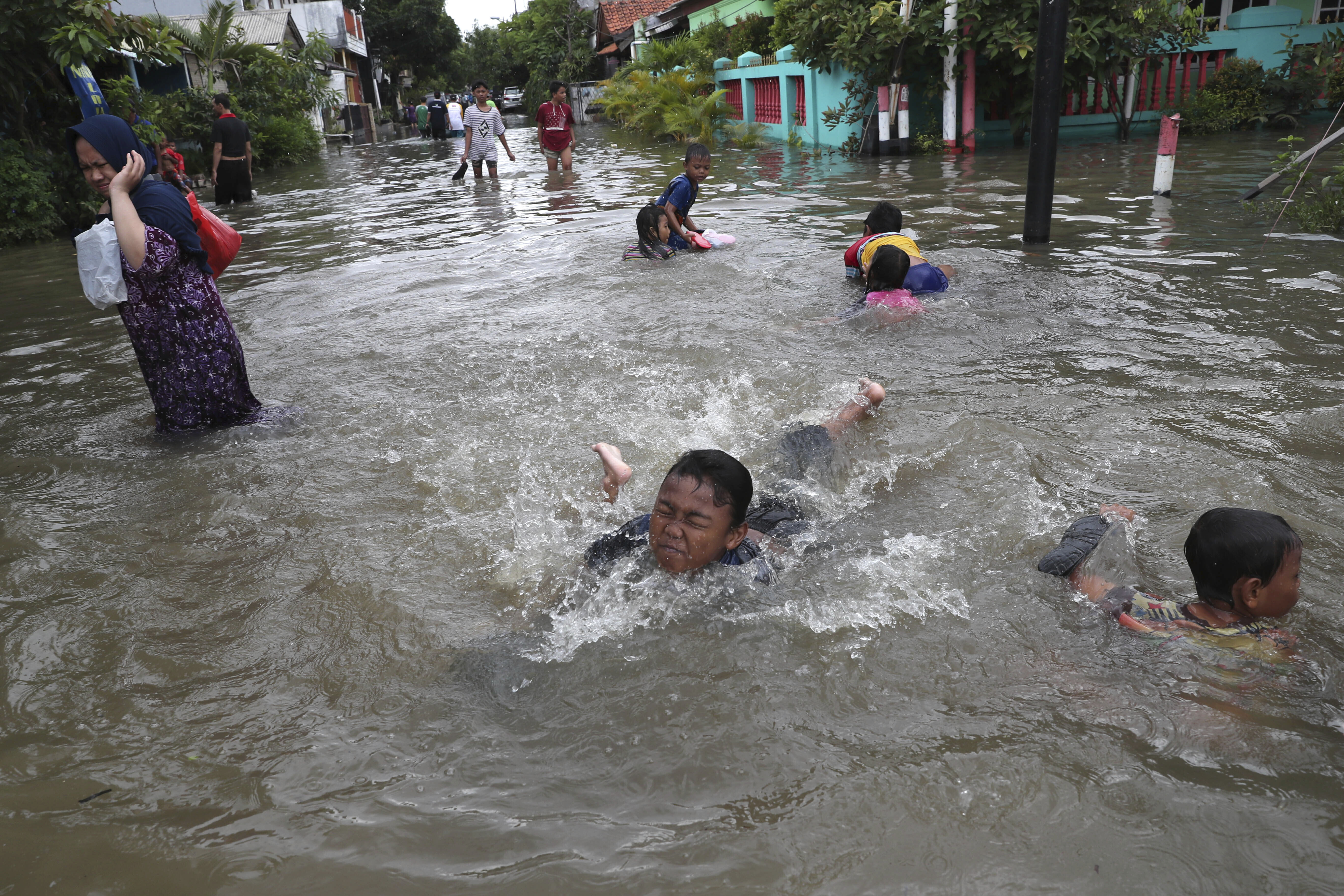 Floods in Indonesia capital recede as death toll reaches 30