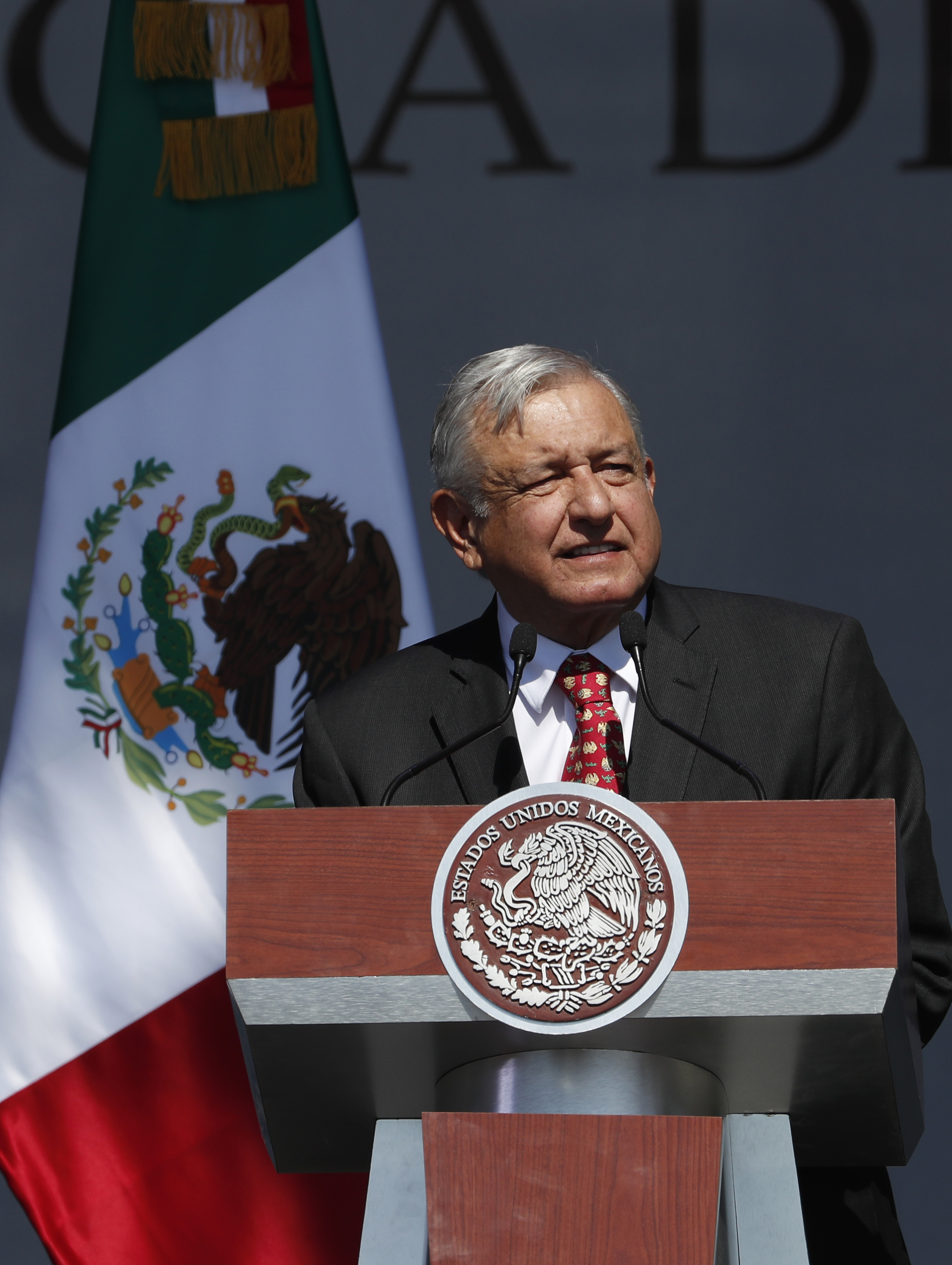 Mexico president marks 1 year in office with party, protests