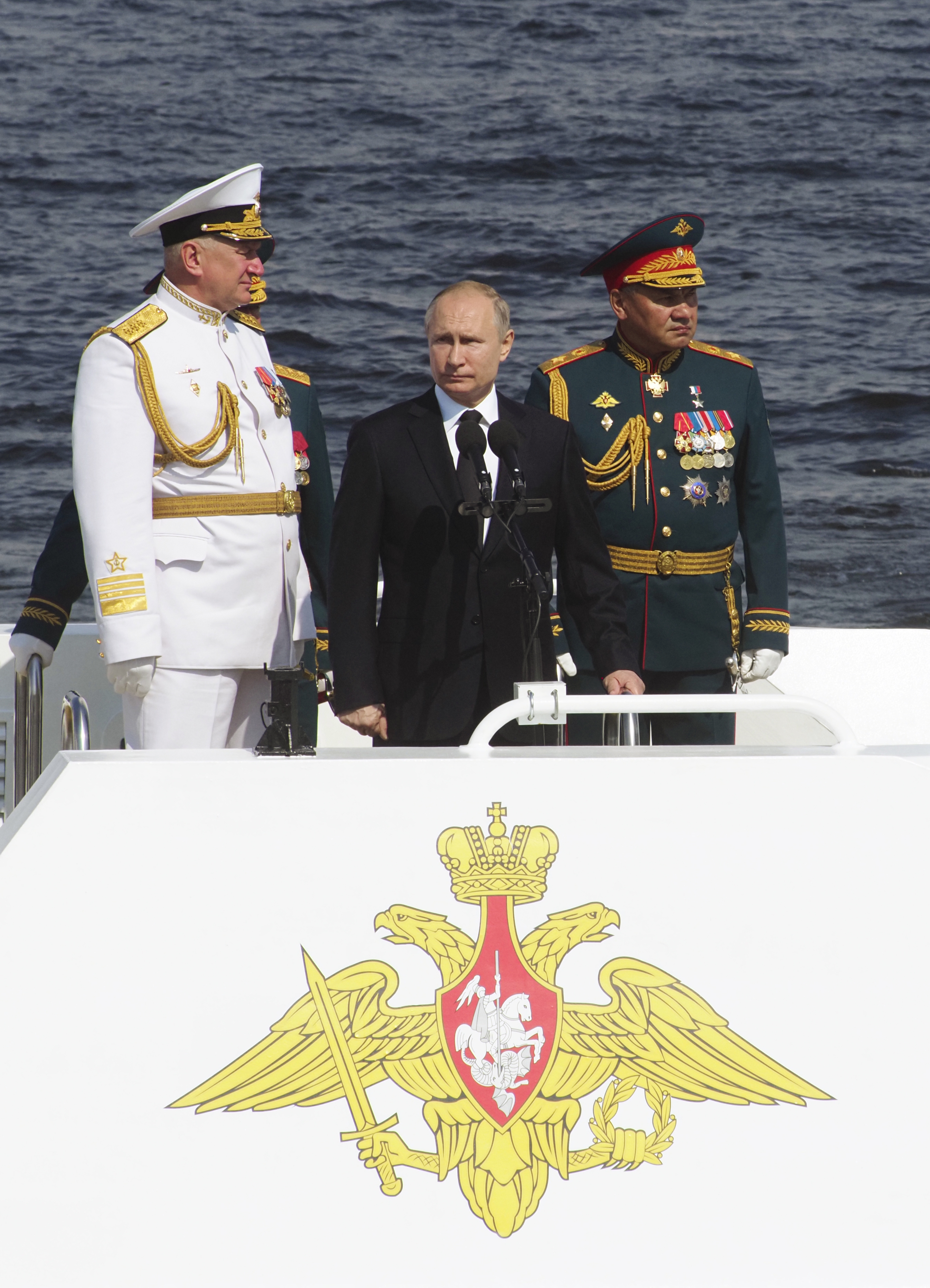 Putin leads Russian naval parade after crackdown in Moscow