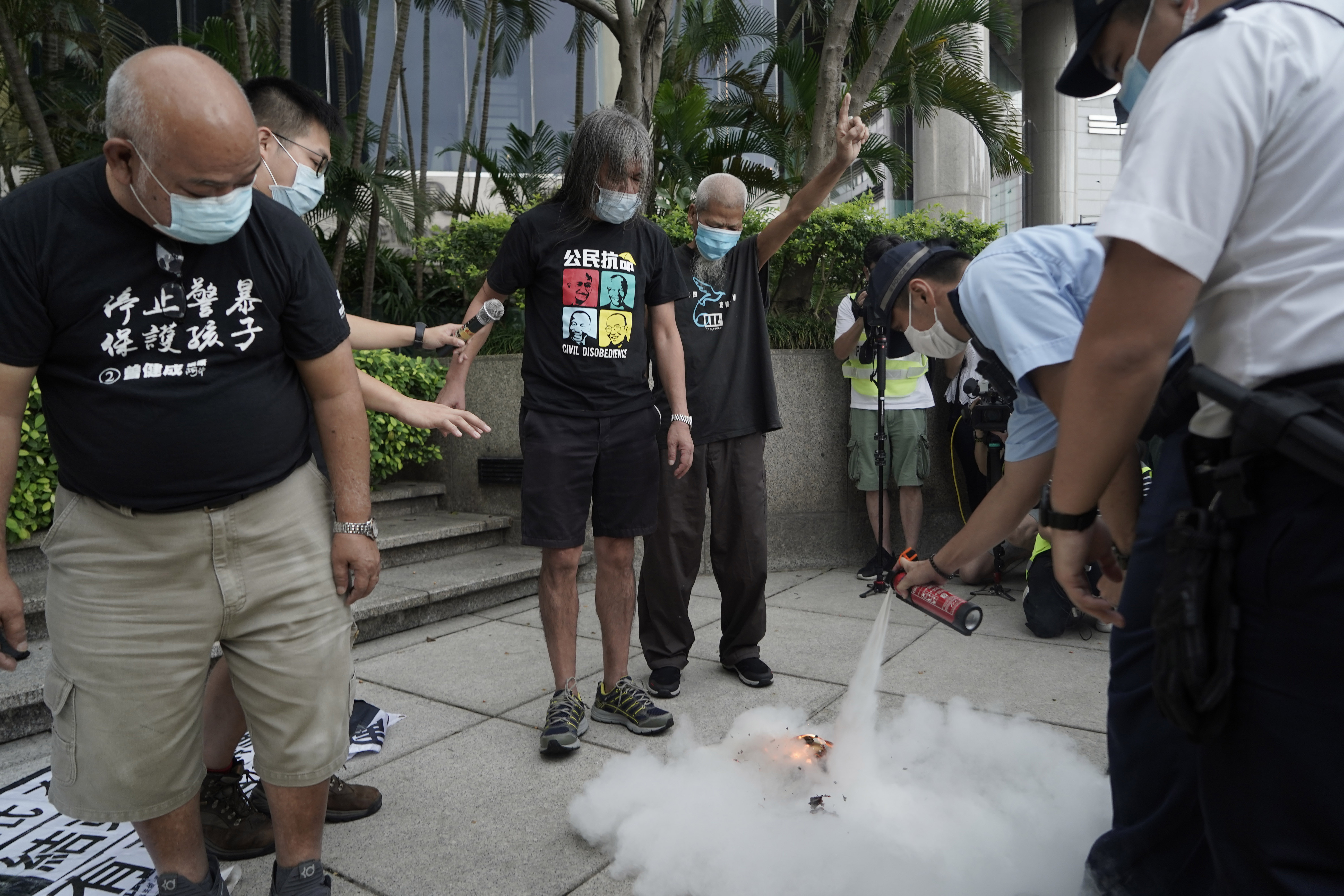 Hong Kong police arrest 60 for protesting on China holiday