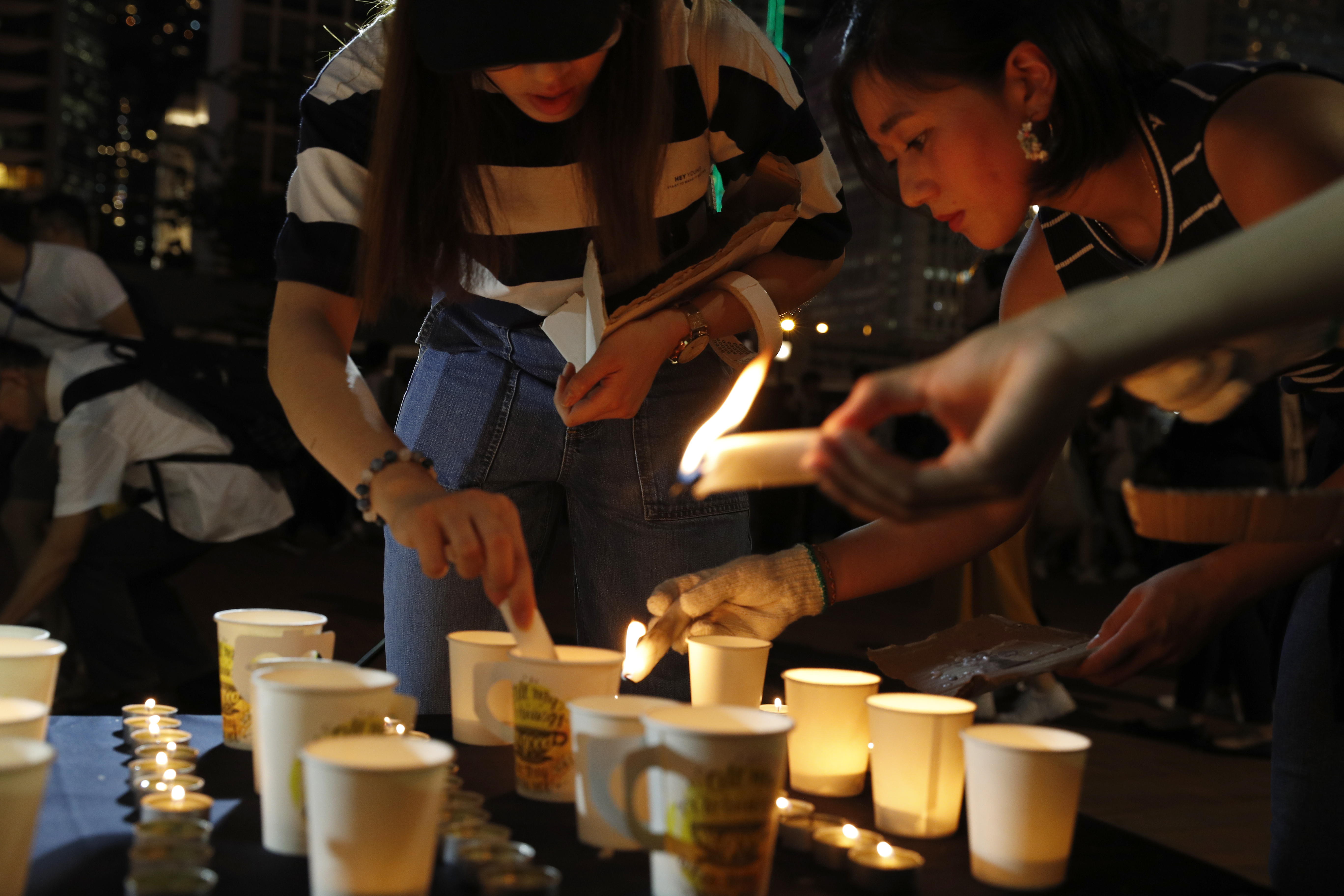 Hong Kong activists hold vigil for deceased supporters