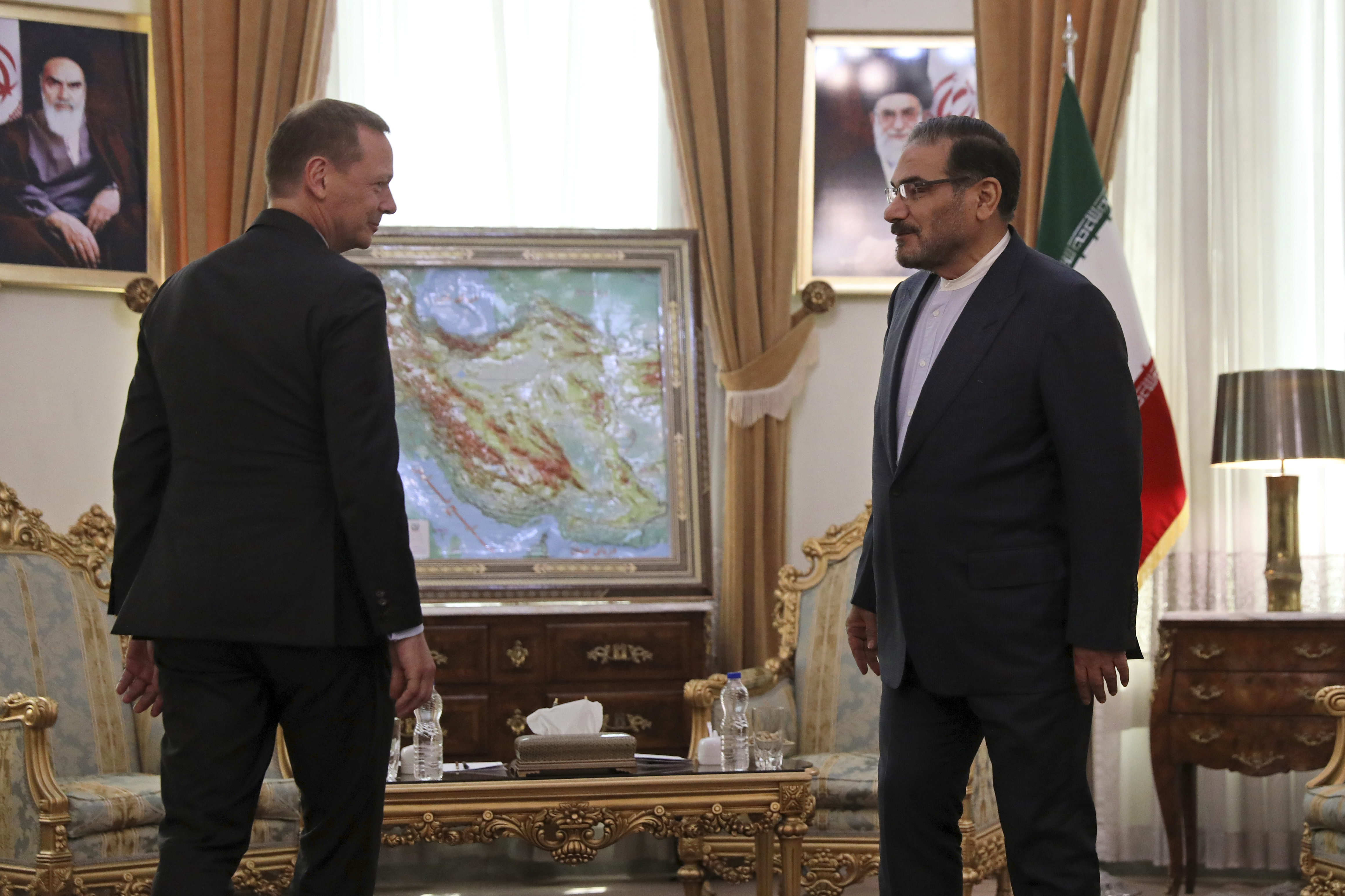 The Latest: Iran says US sanctions are warfare