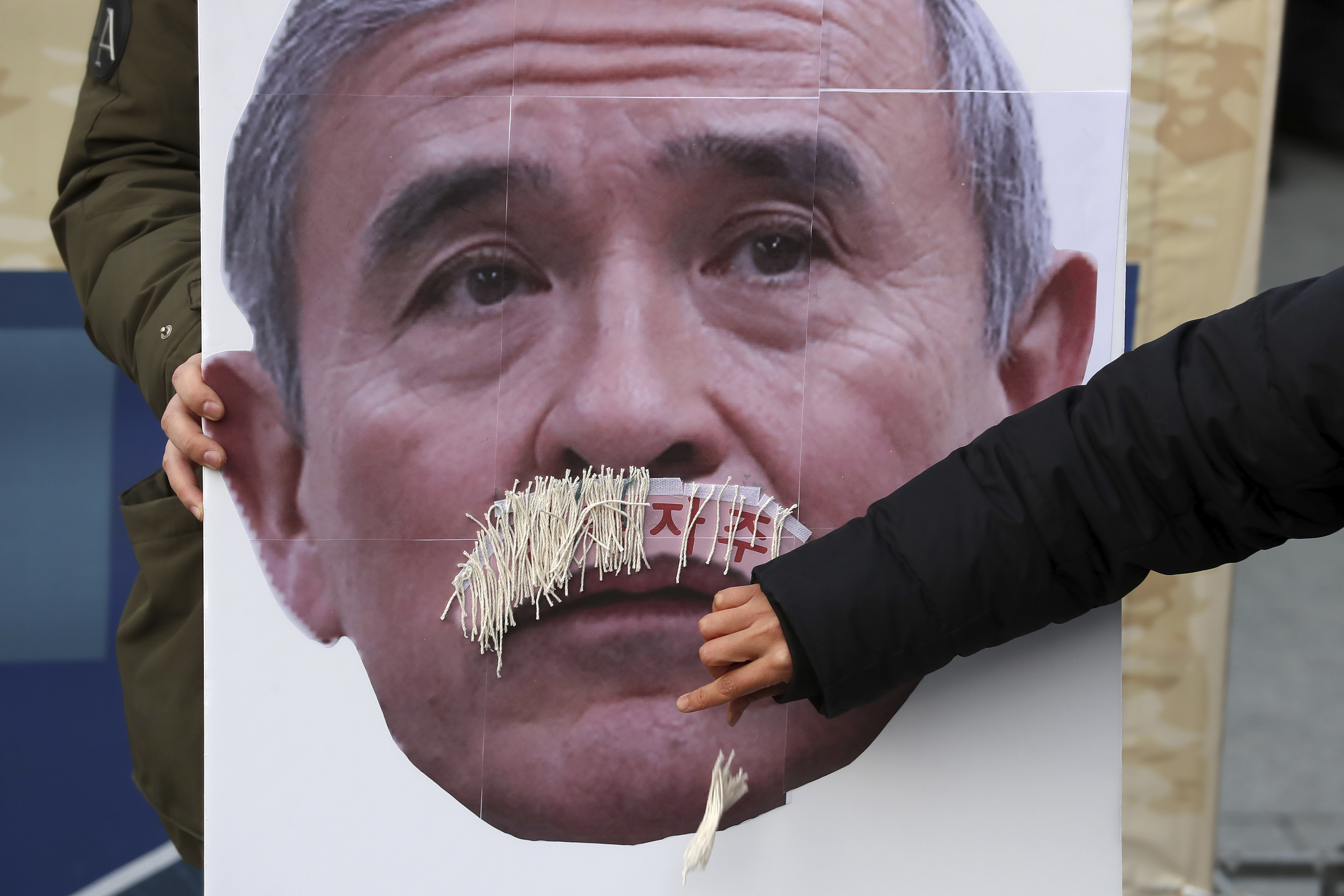 US envoy say its his mustache; South Koreans say otherwise