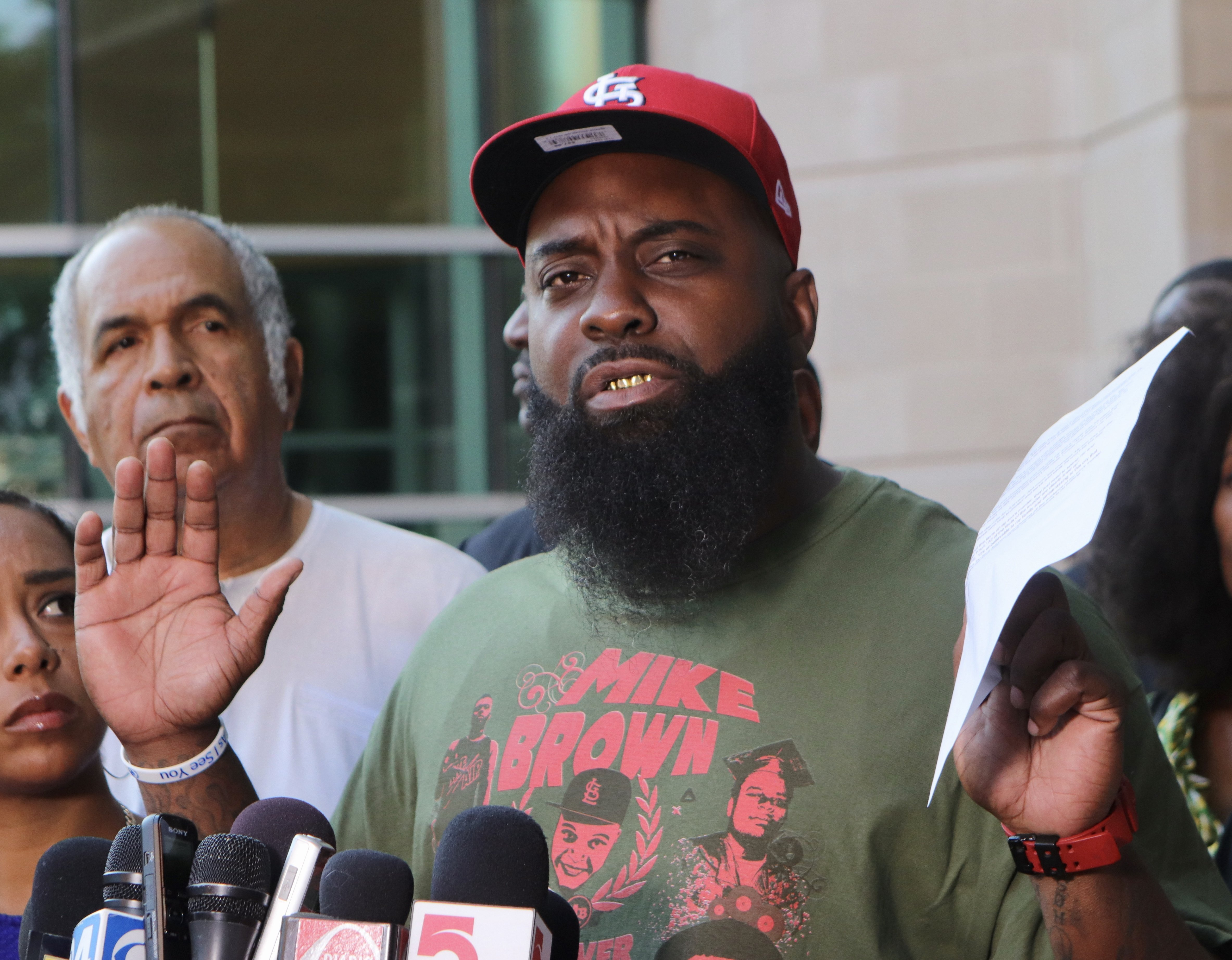 Michael Browns father seeks new investigation into killing