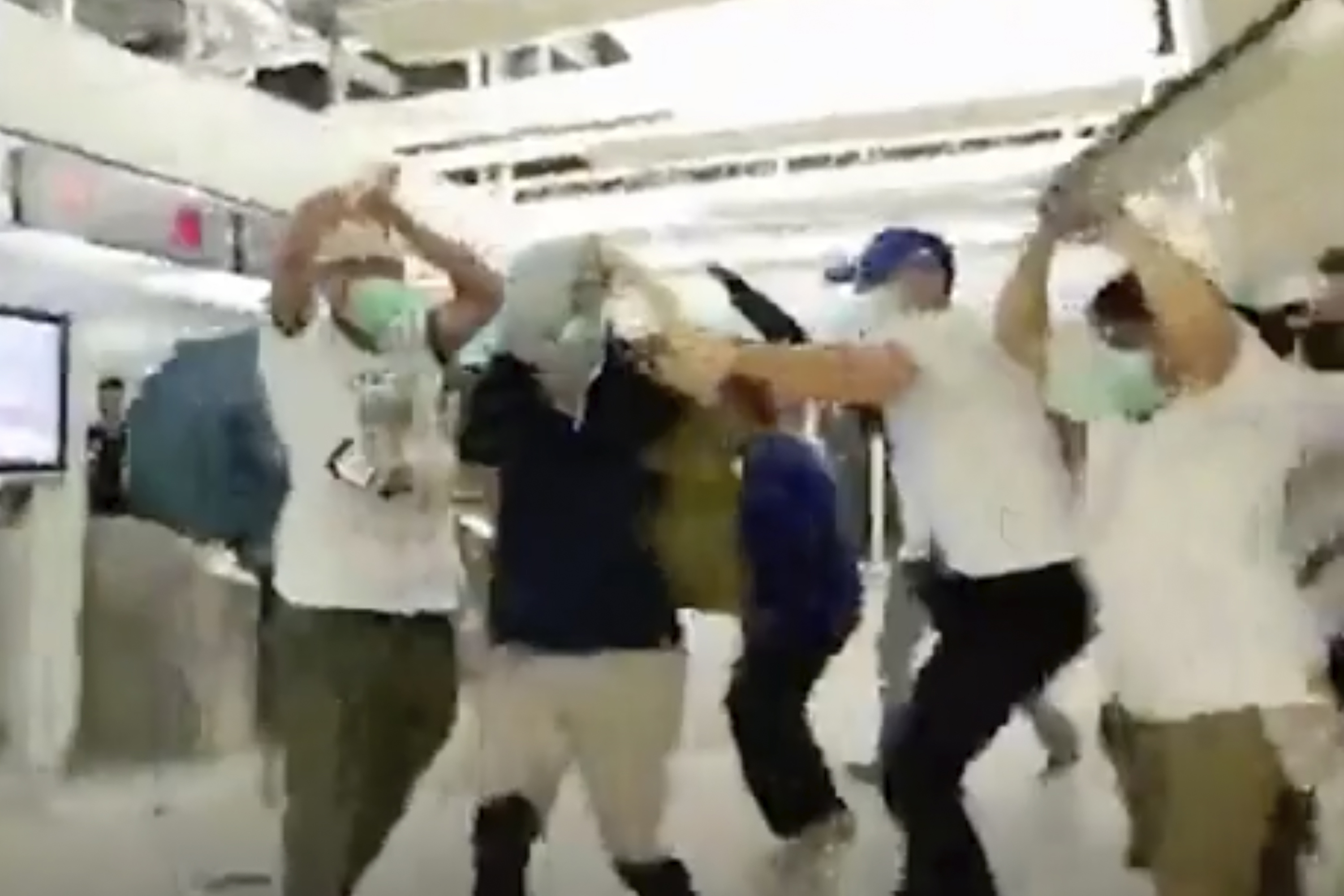 Who are the men in white behind Hong Kongs mob attack?