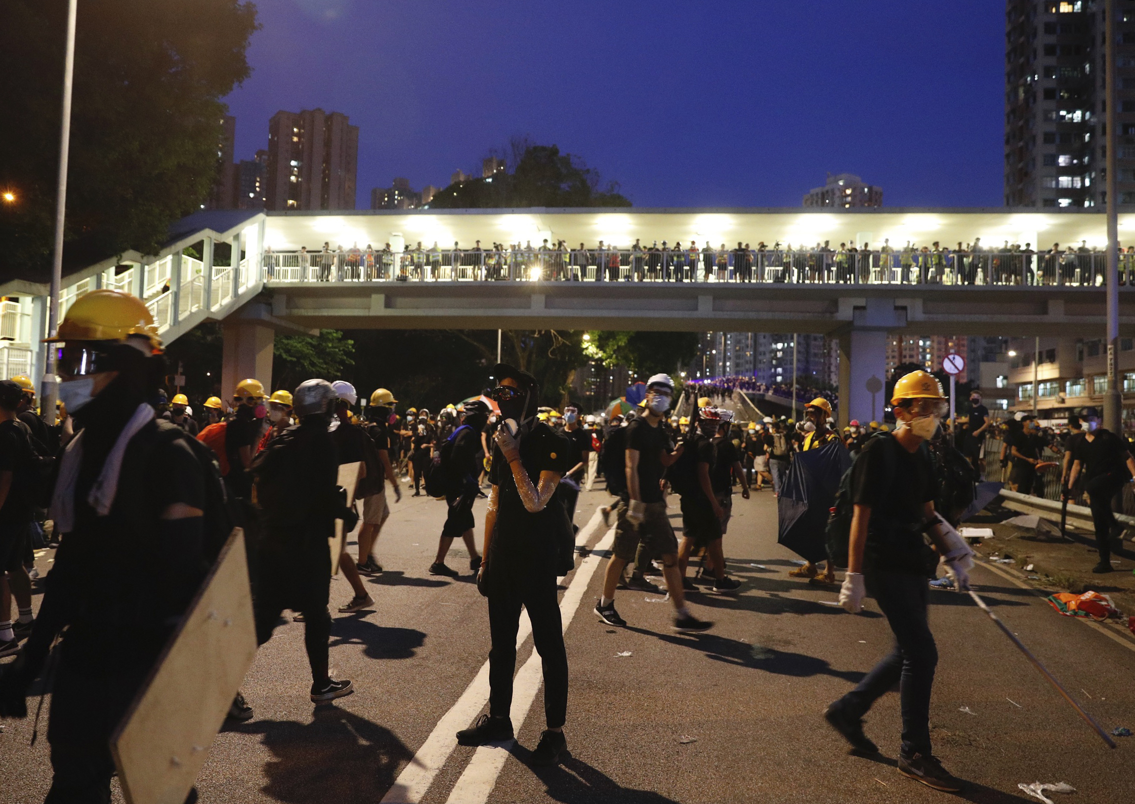 The Latest: Hong Kong police warn protesters of arrest