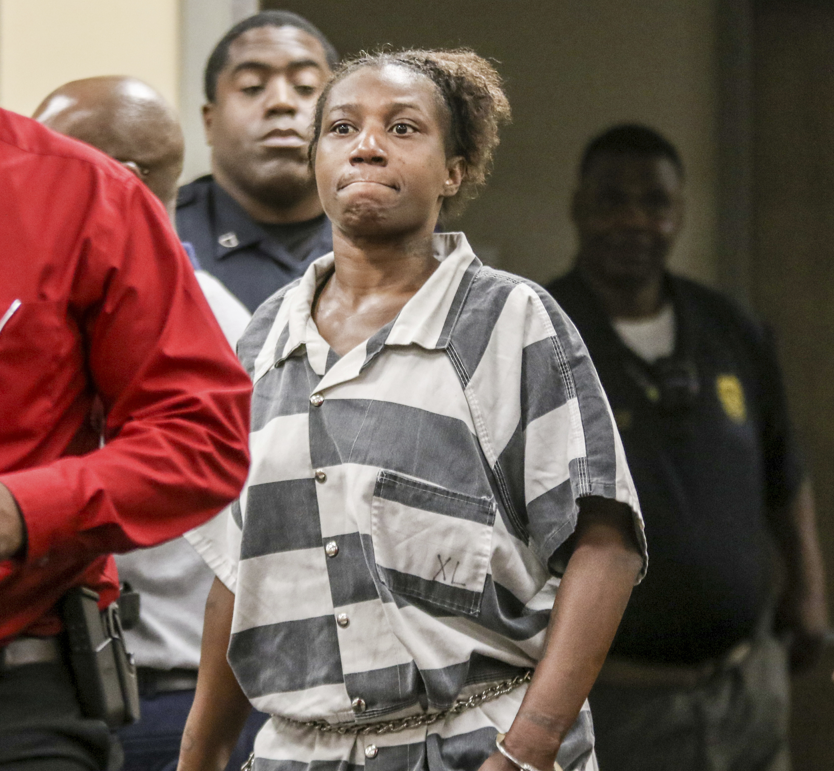 Woman charged; led police to apparent remains of child, 5