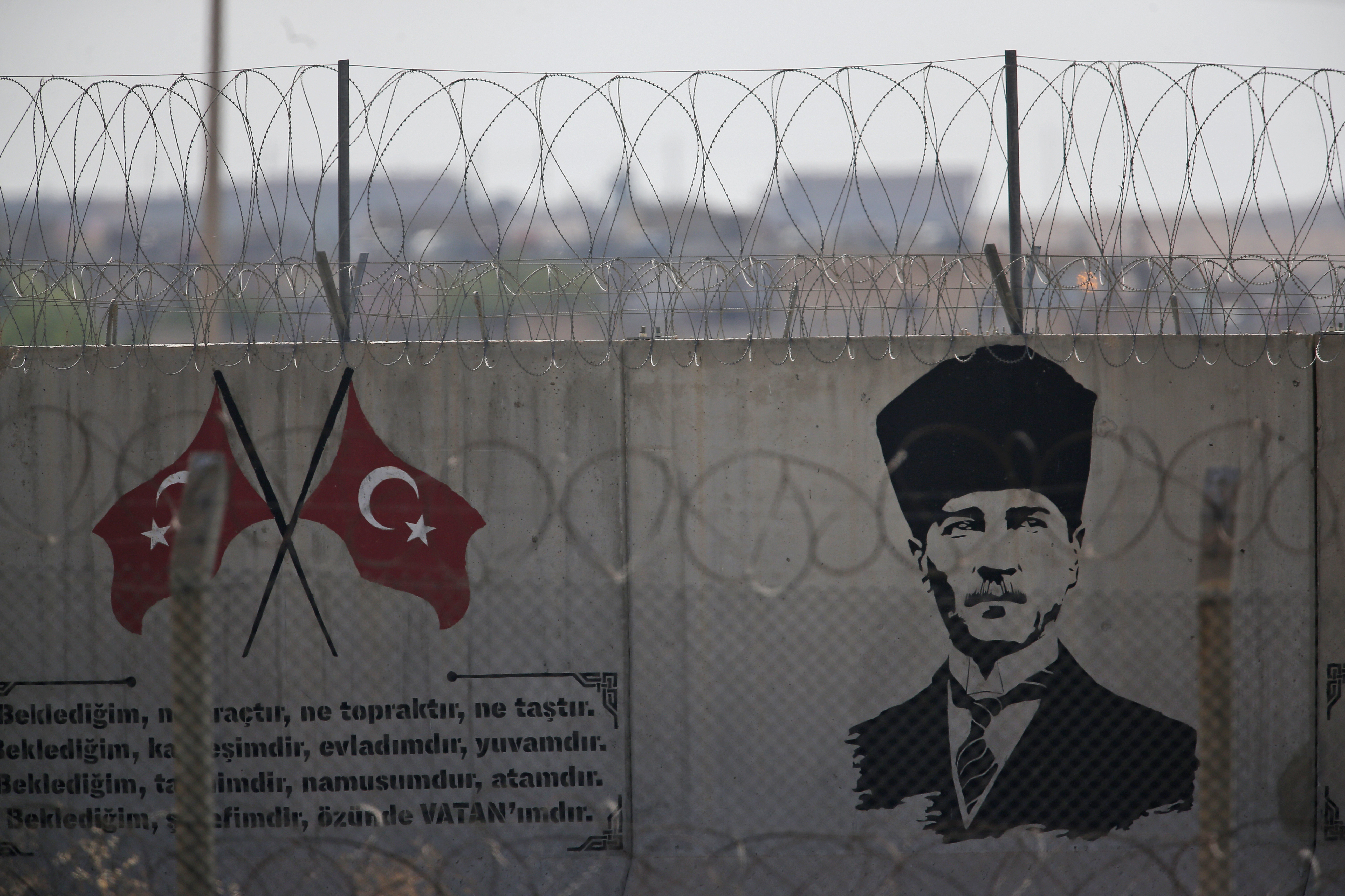 The Latest: Turkey sends reinforcements to border with Syria