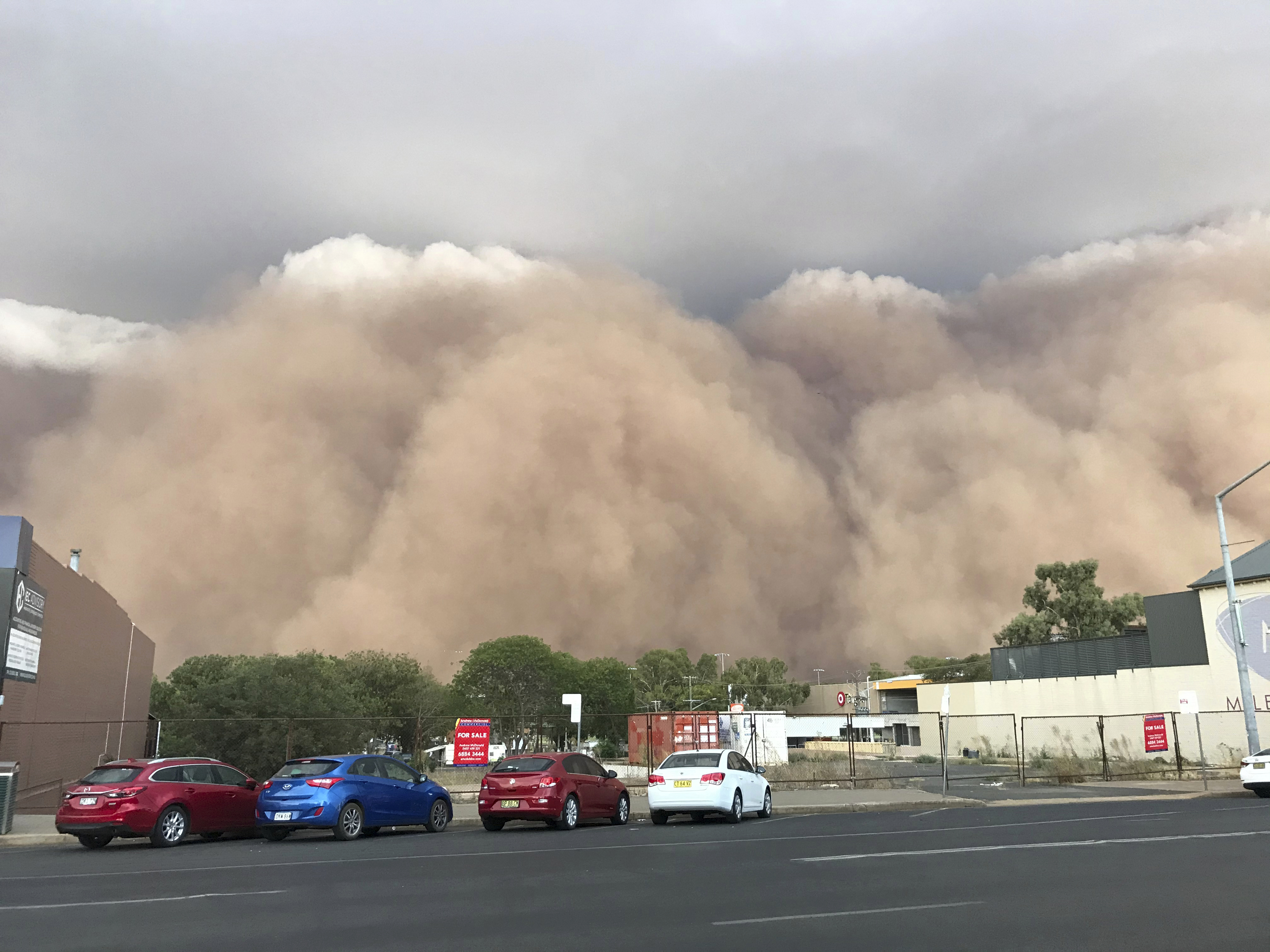 Hail, floods, dust hit Australia amid raging wildfires