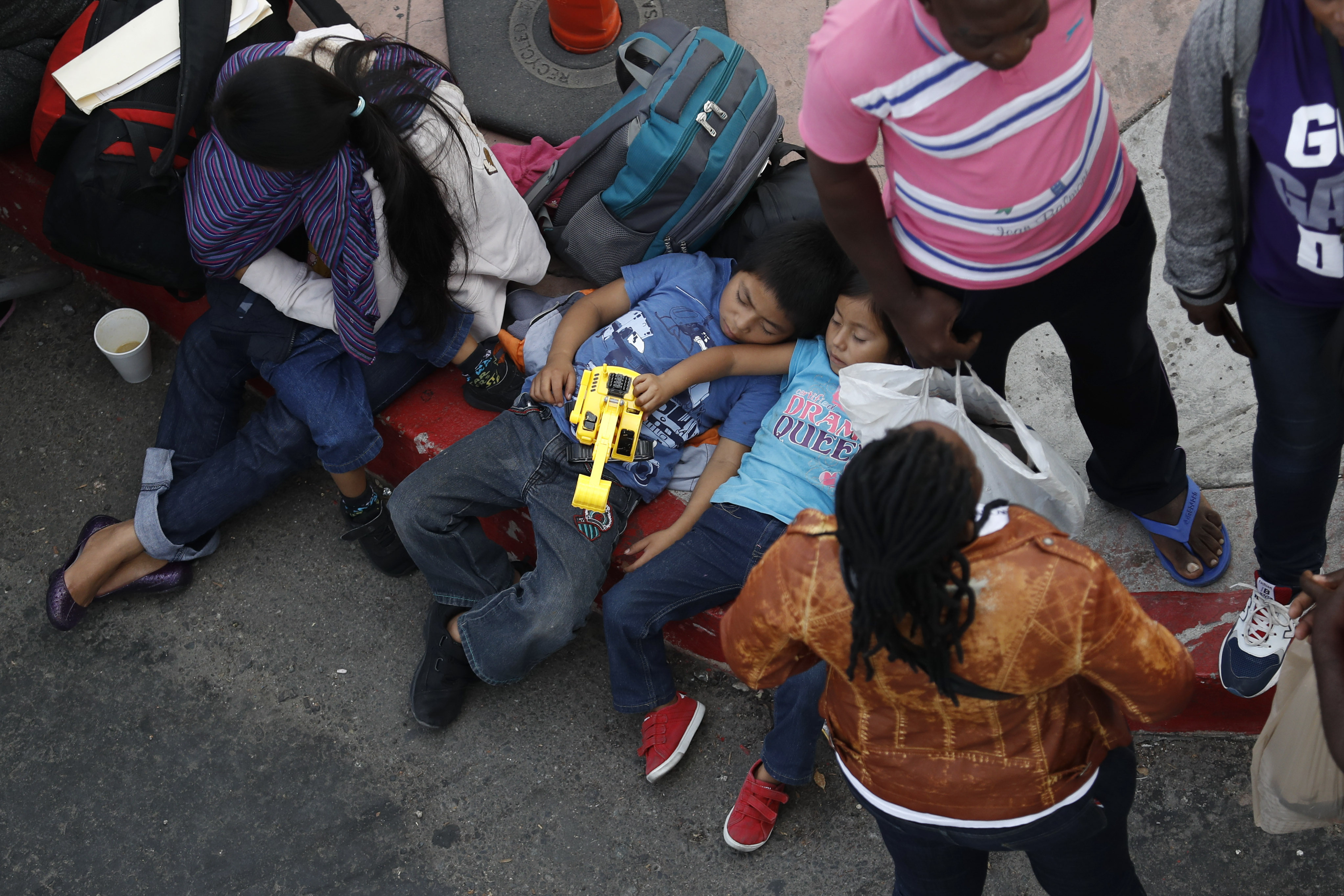 Trumps new asylum rules go into effect, and opponents sue
