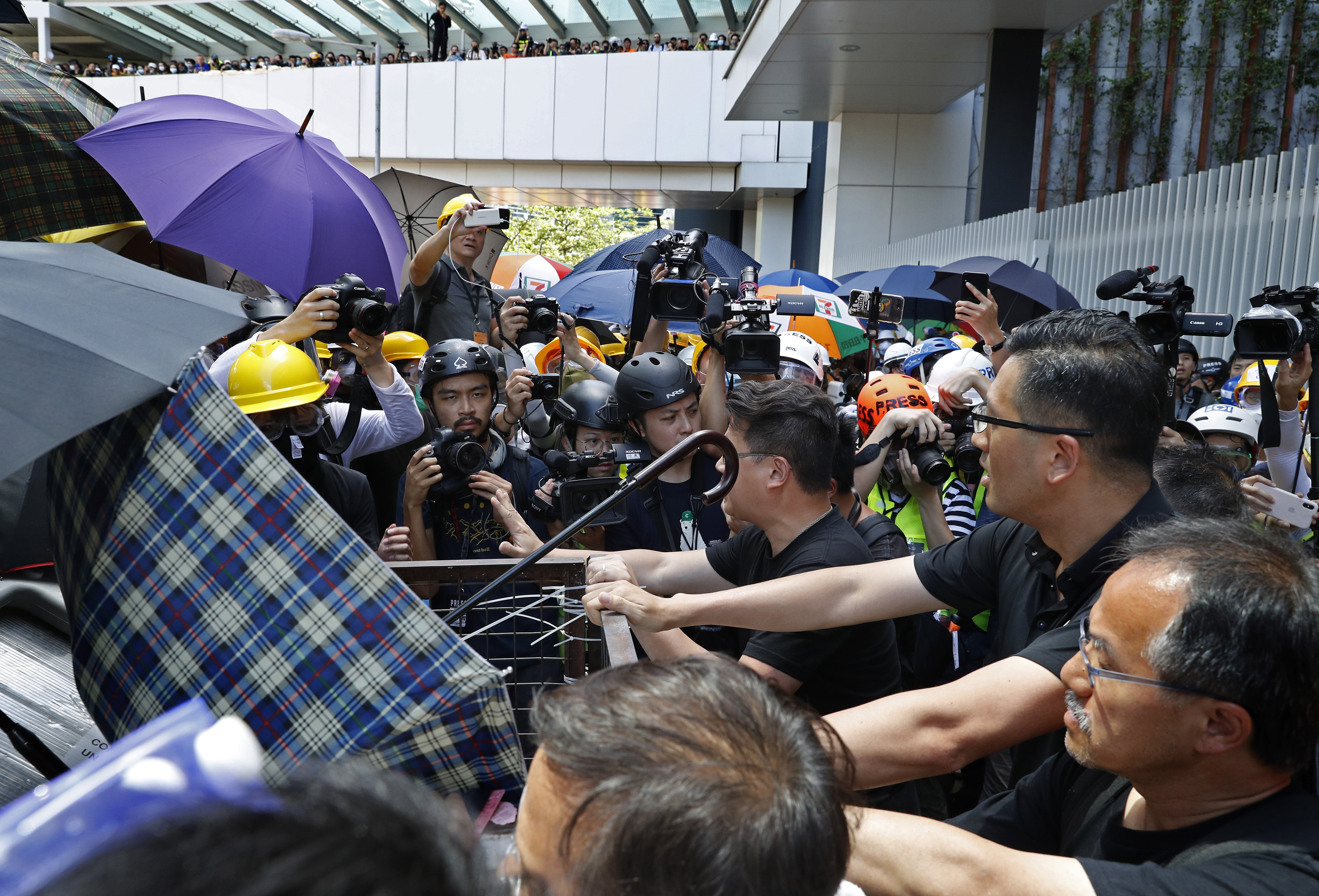 Hong Kong lawmaker: China may boost pressure after violence