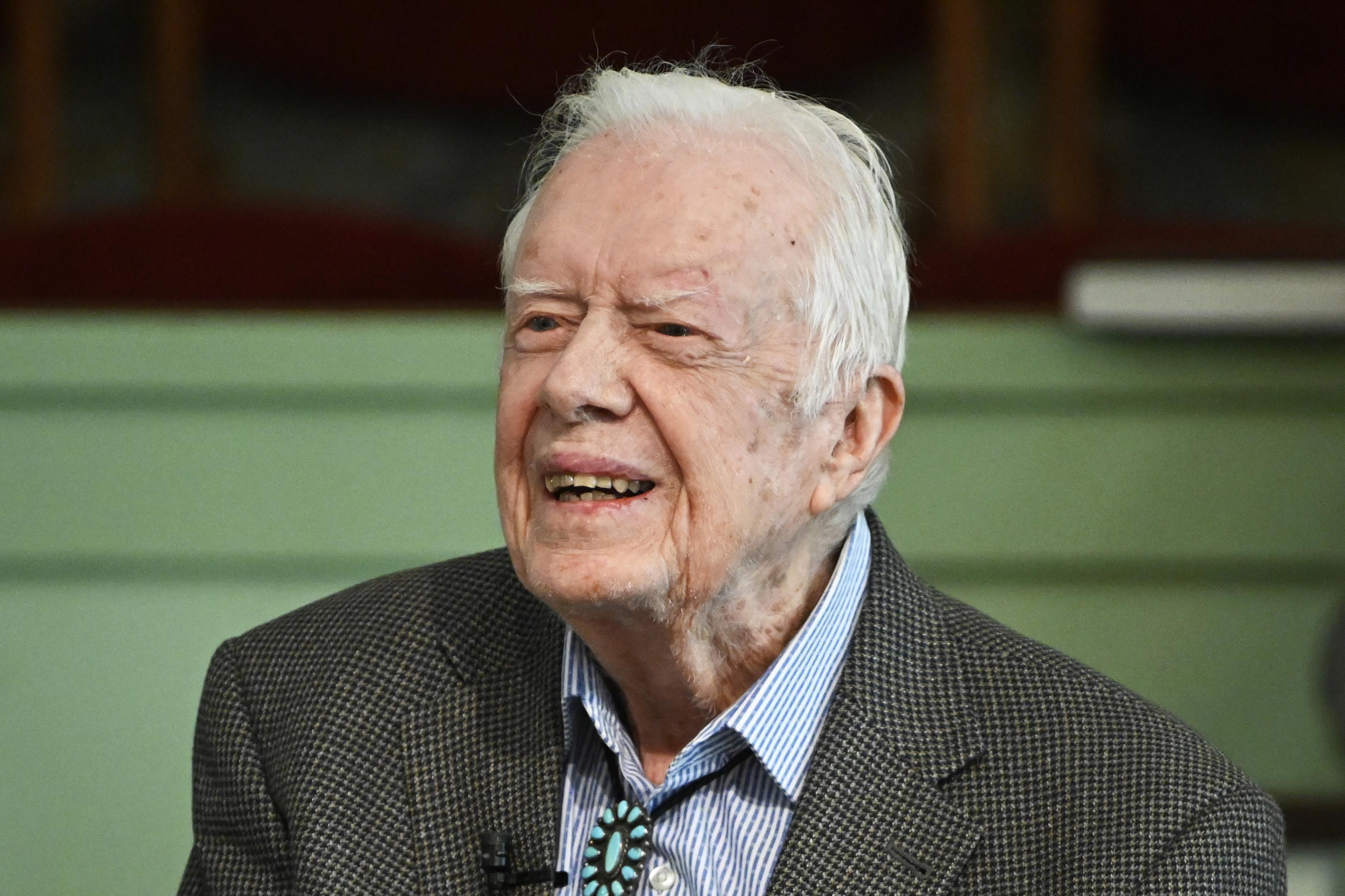 After brain surgery, Jimmy Carter returns to hometown church