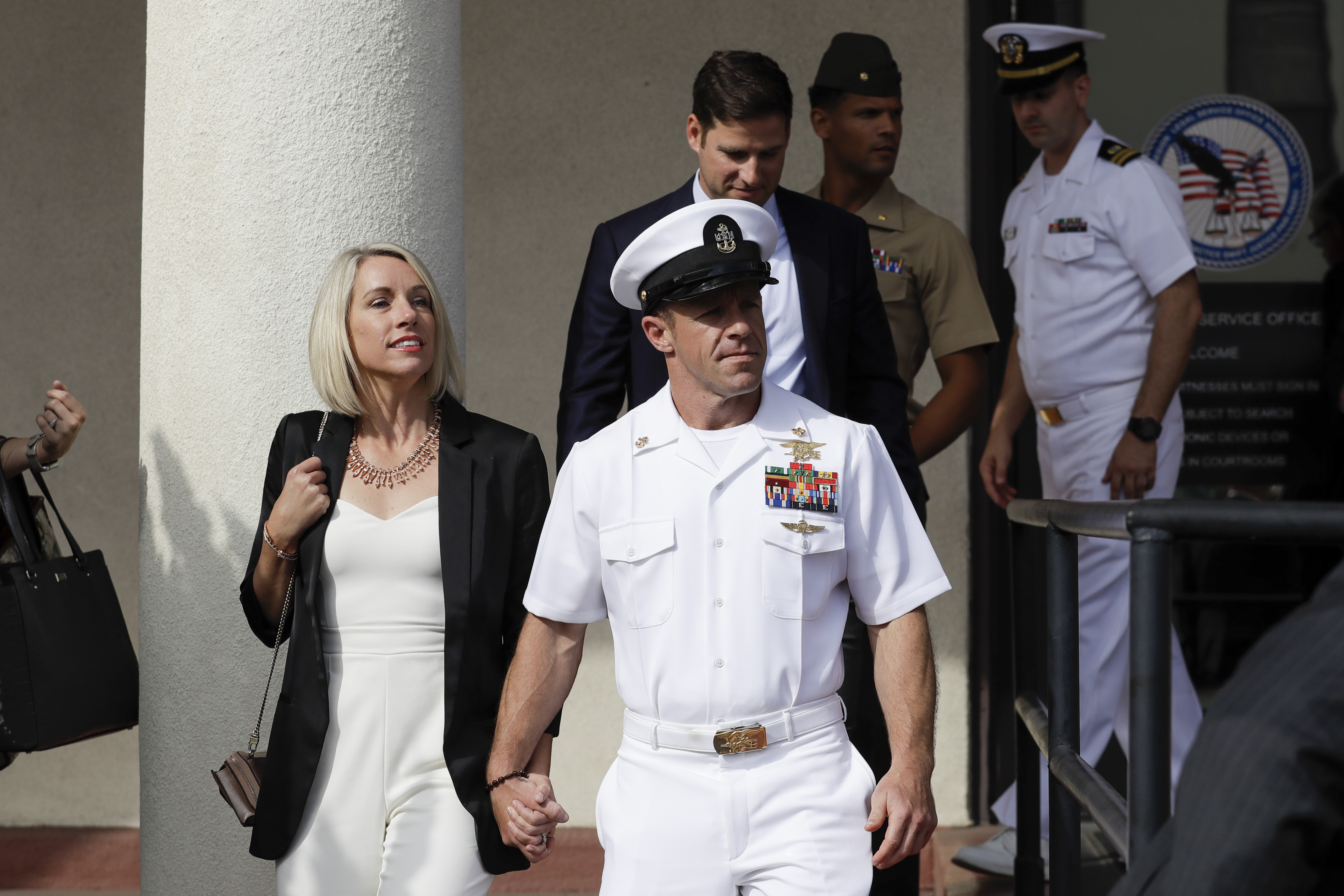 The Latest: Navy SEAL sentenced for posing with dead captive