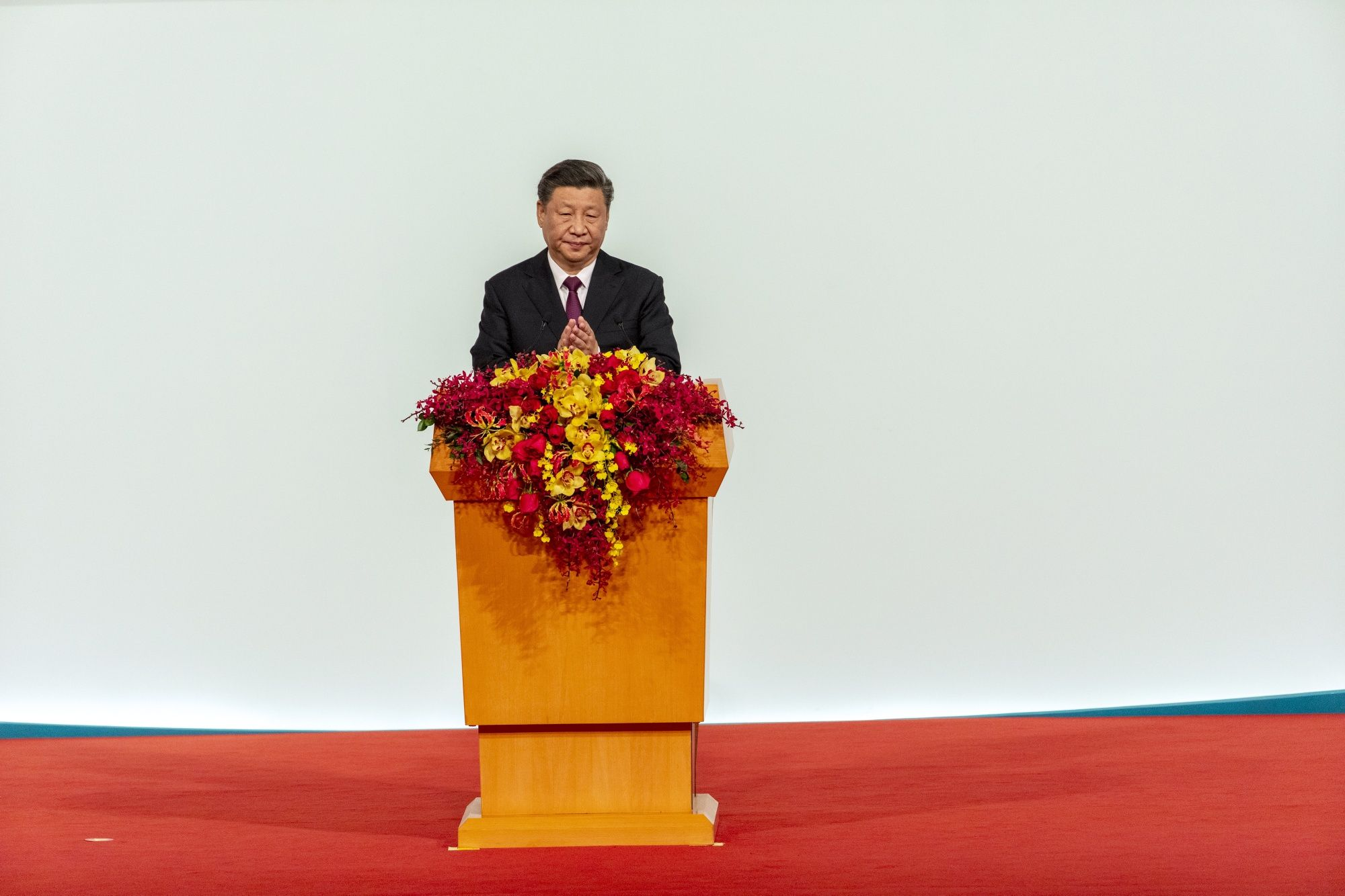 Xi Defends China's Model for Ruling Hong Kong After Restive Year