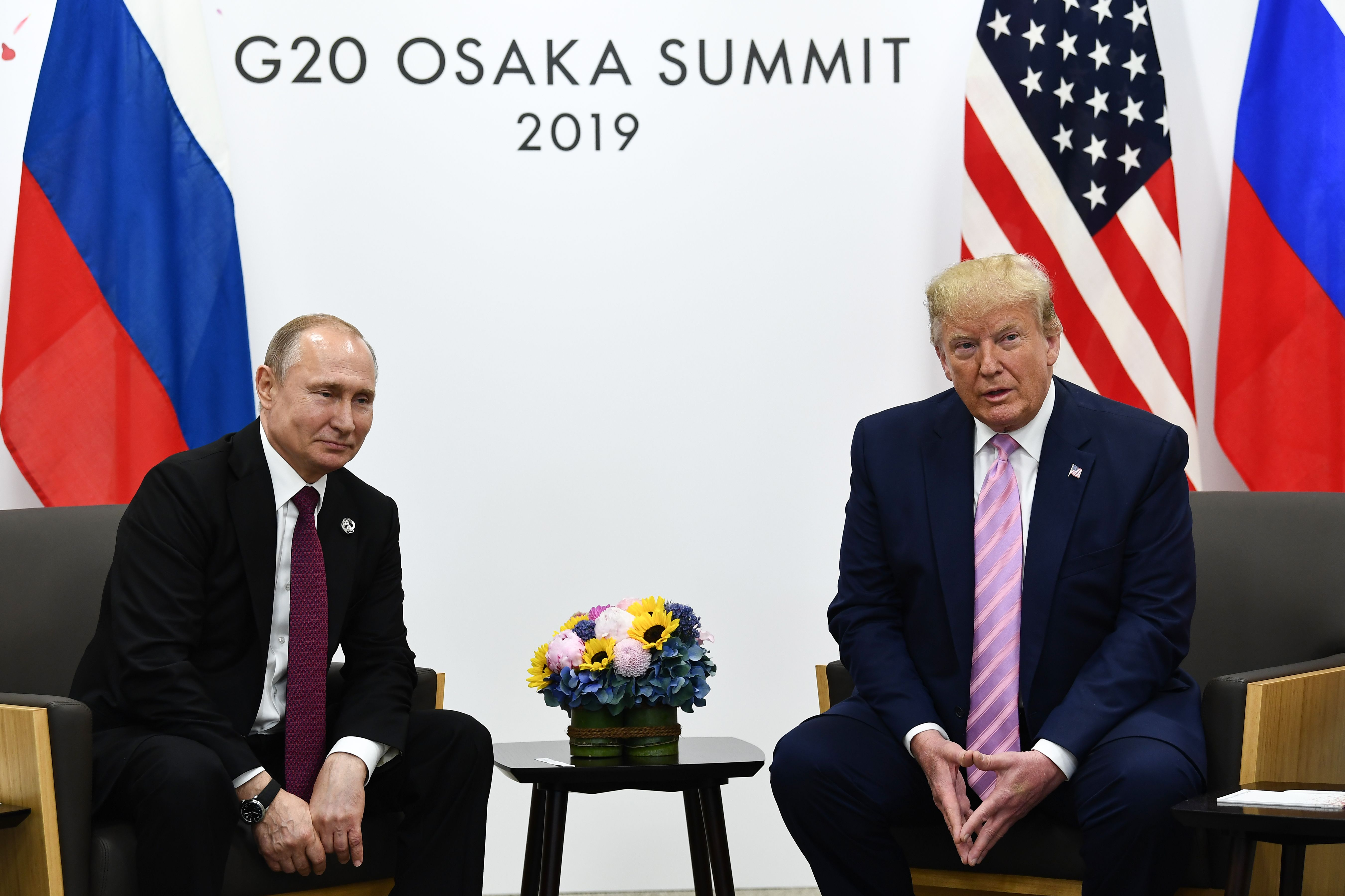 Smiling Trump Tells Putin at G-20 Not to Meddle in U.S. Election