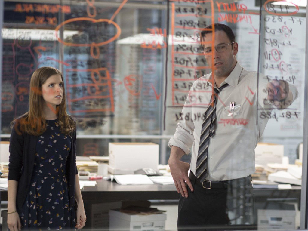 """Ben Affleck (R) in a scene with co-star Anna Kendrick in 2016's """"The Accountant""""."""