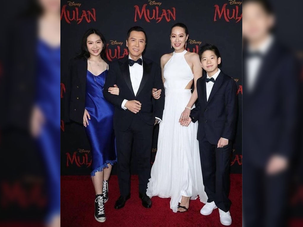Donnie Yen walks the red carpet with his family.