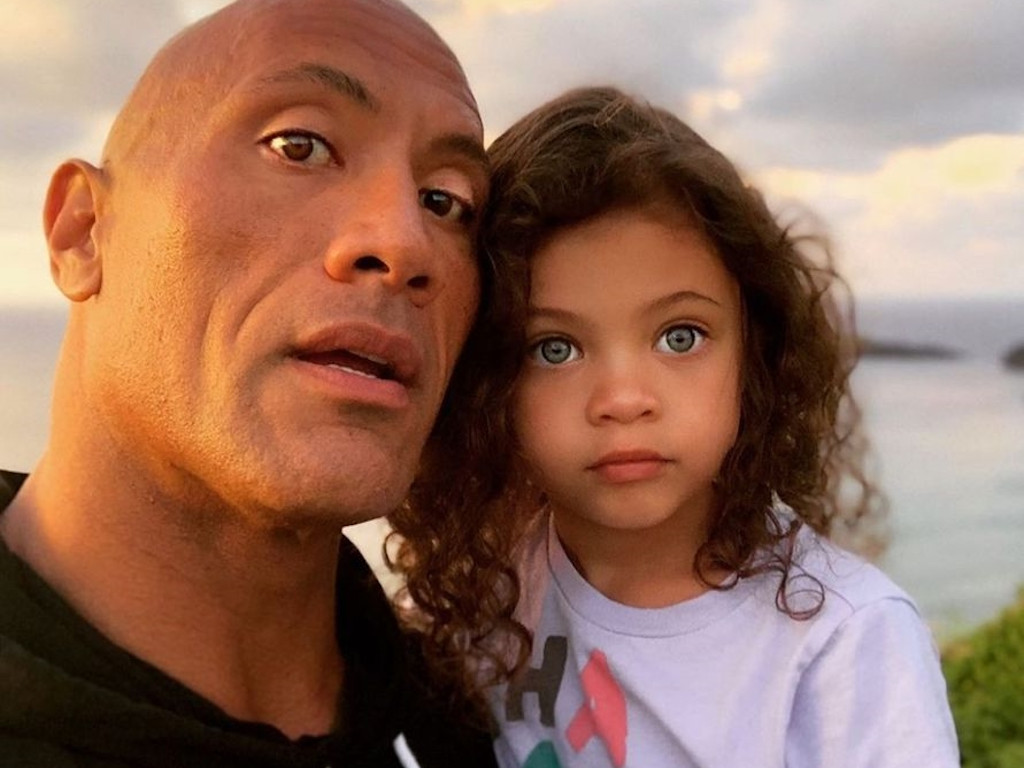 Dwayne Johnson seen here with one of his daughters.